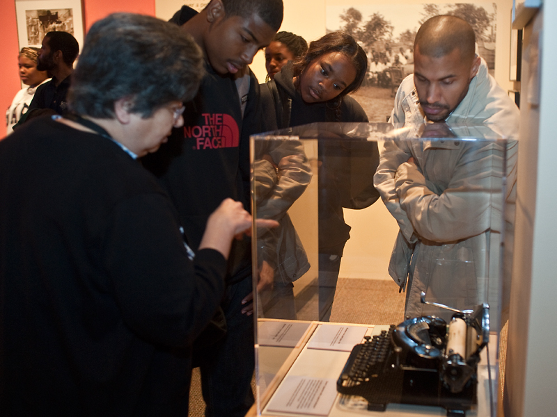Curator Alcione Amos shows the Lorenzo Dow Turner exhibit to area high school students during their visit on Career Day, May 19, 2011.