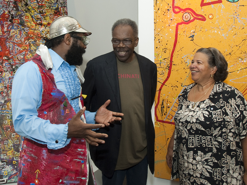 Artist BK Adams (right) with ACM former board member Sam Gilliam and museum director Camille Akeju at the opening of the exhibition Exercise Your Mynd.