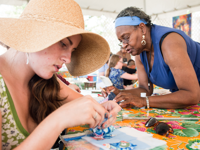 The Daughters of Dorcas and Sons conduct a quilting workshop at Citified, ACM's portion of the 2012 Folklife Festival.