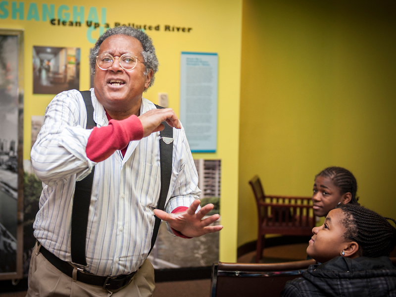 "Bob ""the Griot"" Smith tells stories to young people at a Mardi Gras program."