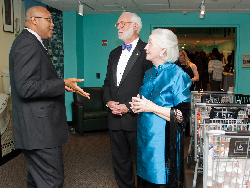 Docent Robert Lee gives Smithsonian Secretary G. Wayne Clough and his wife, Anne, a tour of Reclaiming the Edge at the museum's 45th anniversary gala.