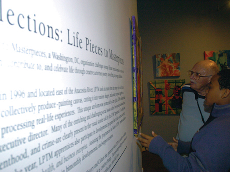 A member of Life Pieces to Masterpieces discusses his artwork displayed in the Reflections exhibition.