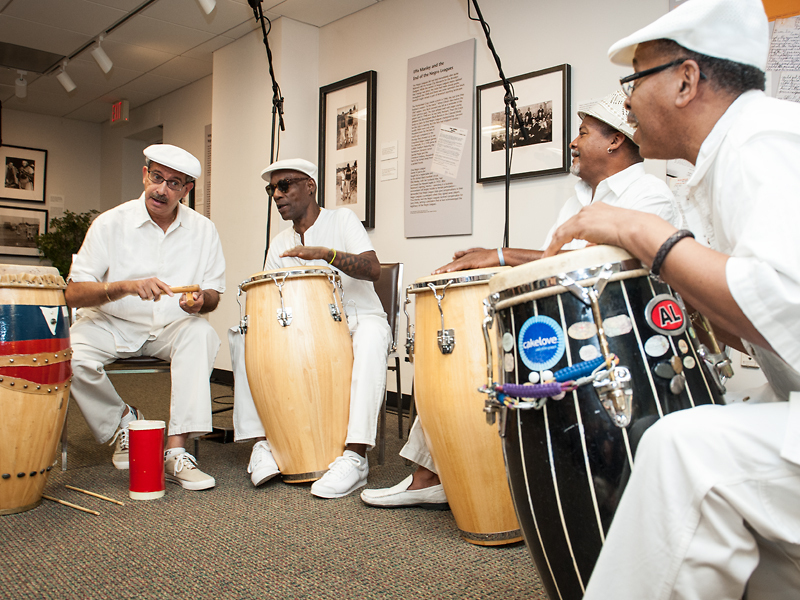 "The Metro Mambo Series drum circle with musicians Rudy Morales, William ""Rashidi"" Bowe, Rob White, and Sam ""Seguito"" Turner"