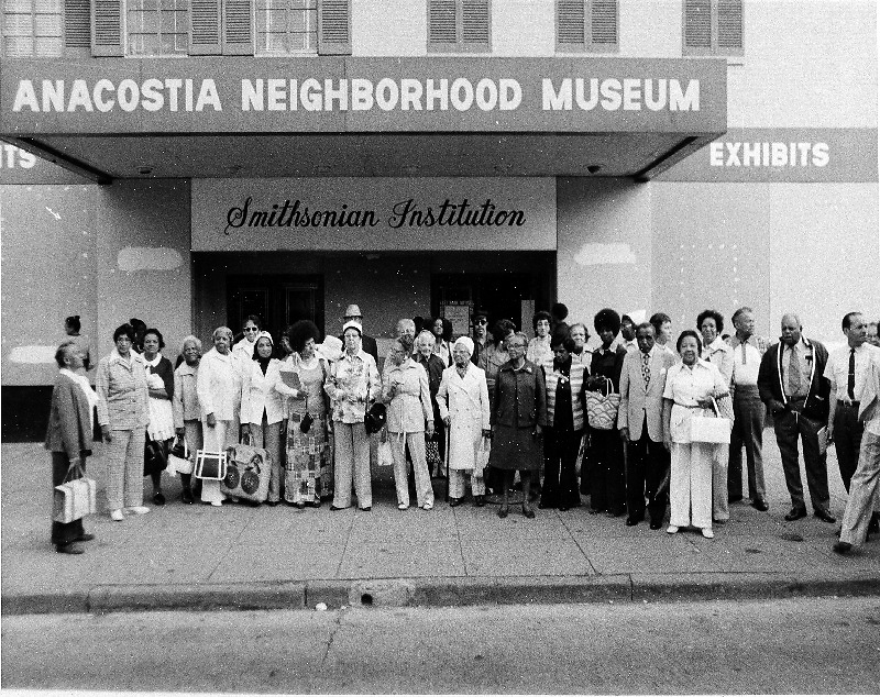 ANM Historian Louise Daniel Hutchinson (front row, 7th from left) and the Anacostia Historical Society at the museum's first home, the Carver Theater