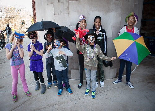 Children pose after the Carnival Second Line paraded through the museum at the annual Mardi Gras Family Day.