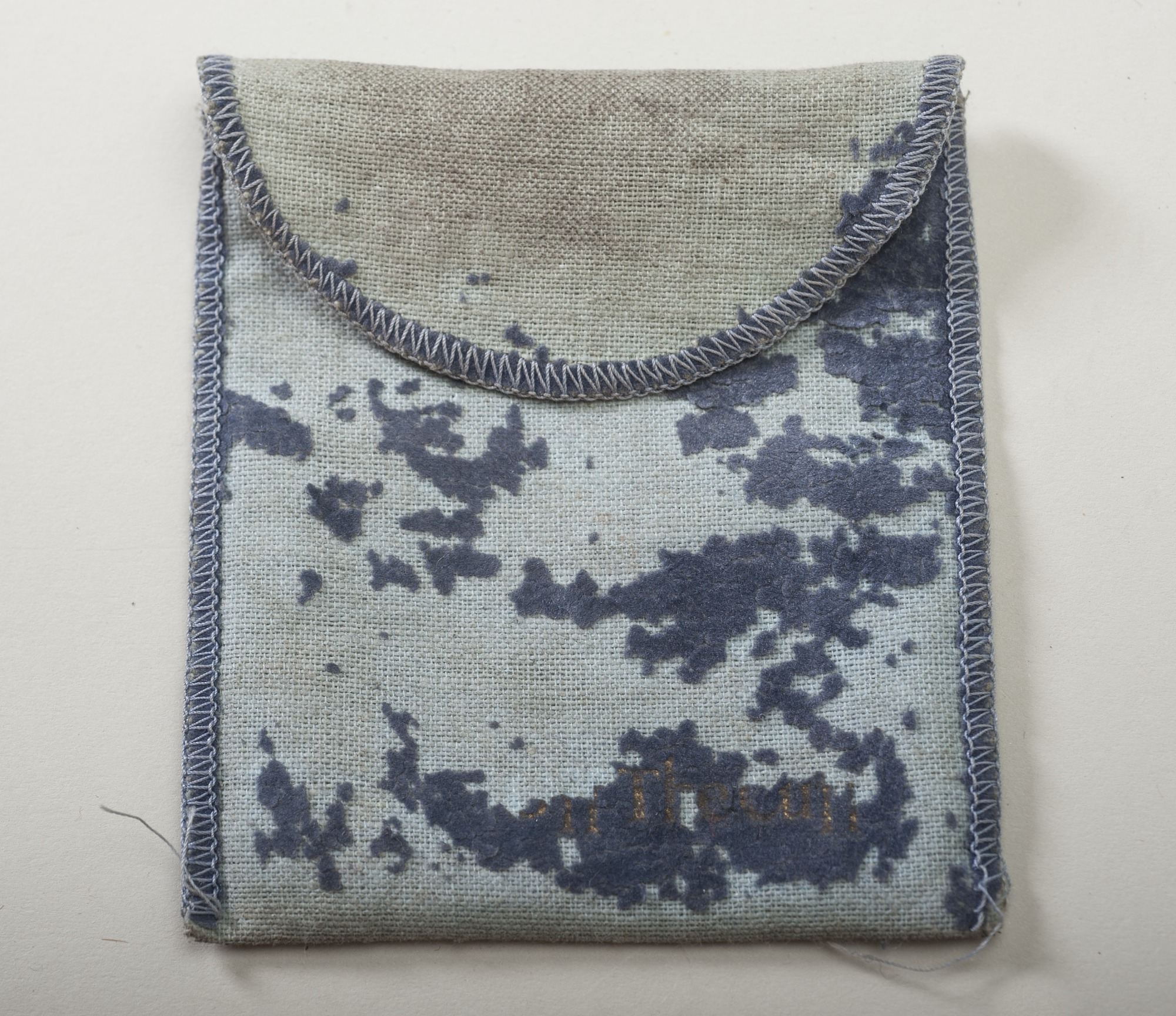 Blue cloth jewelry bag for jewelry box.