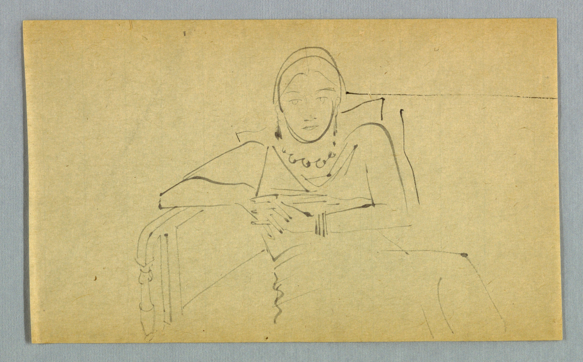 Female Seated on Sofa