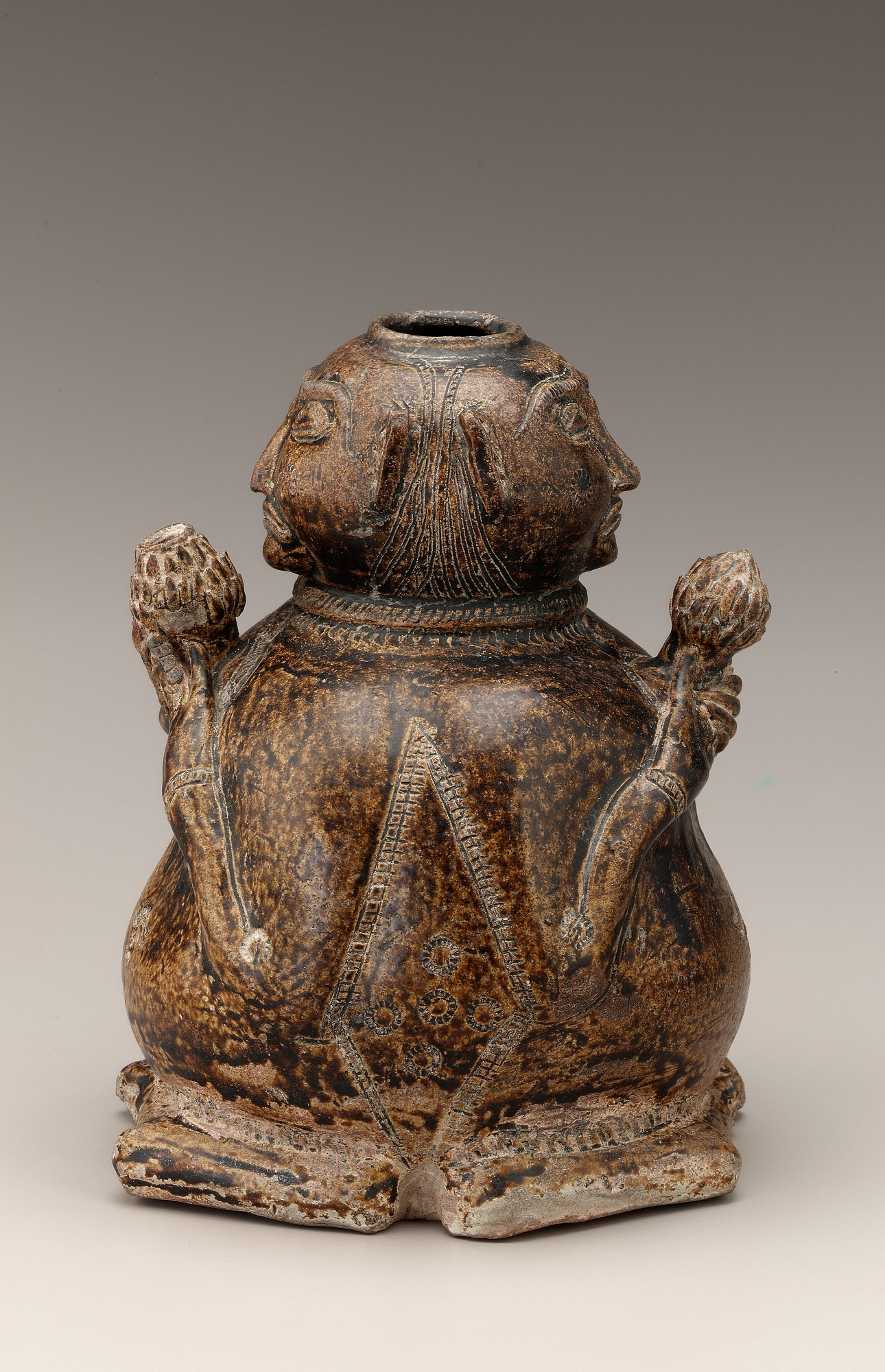 side: Vessel in the form of two human figures
