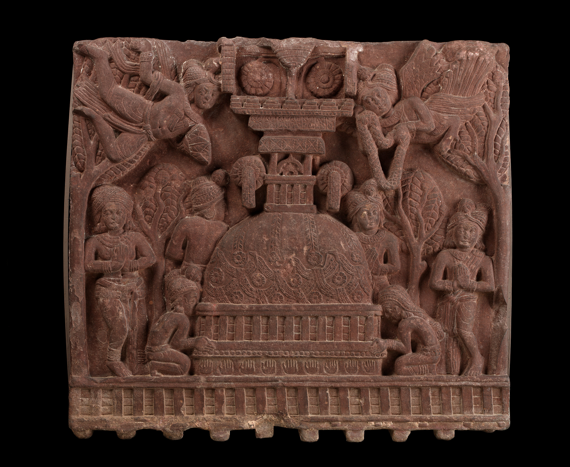 One face of a fence-rail from Bharhut: Worship at a Stupa