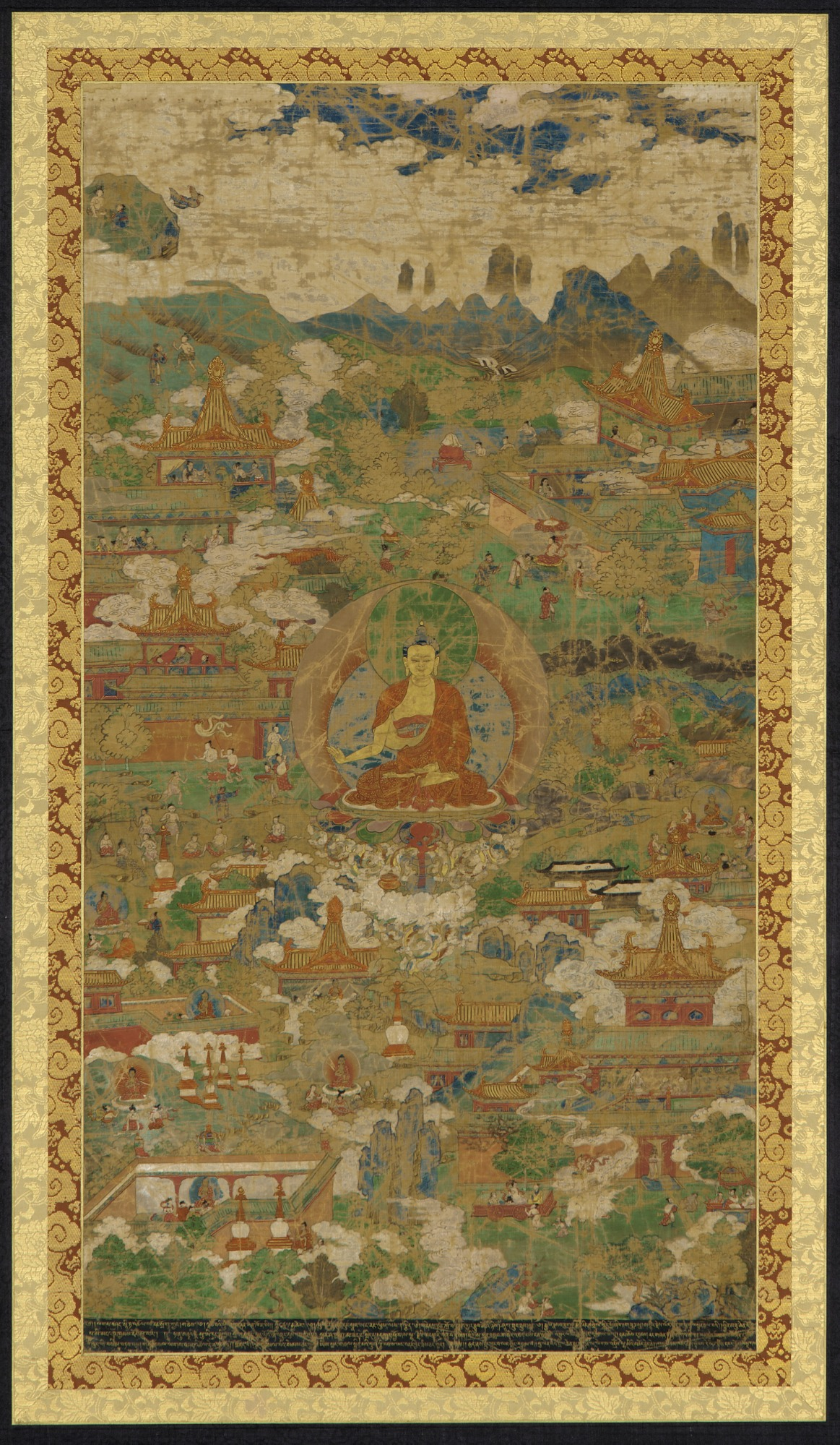 : The Buddha, Sakyamuni, surrounded by biographical scenes