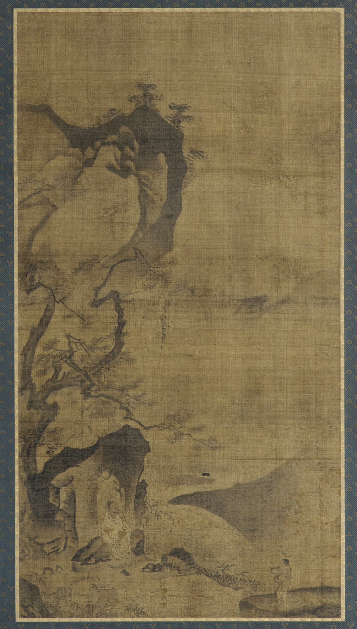 : Landscape: mountains and water; a figure under a pine tree