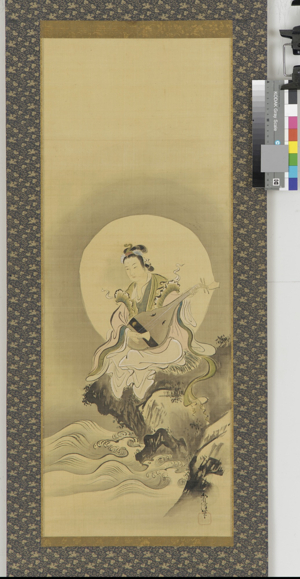 Benten (Sarasvati) seated on a rock