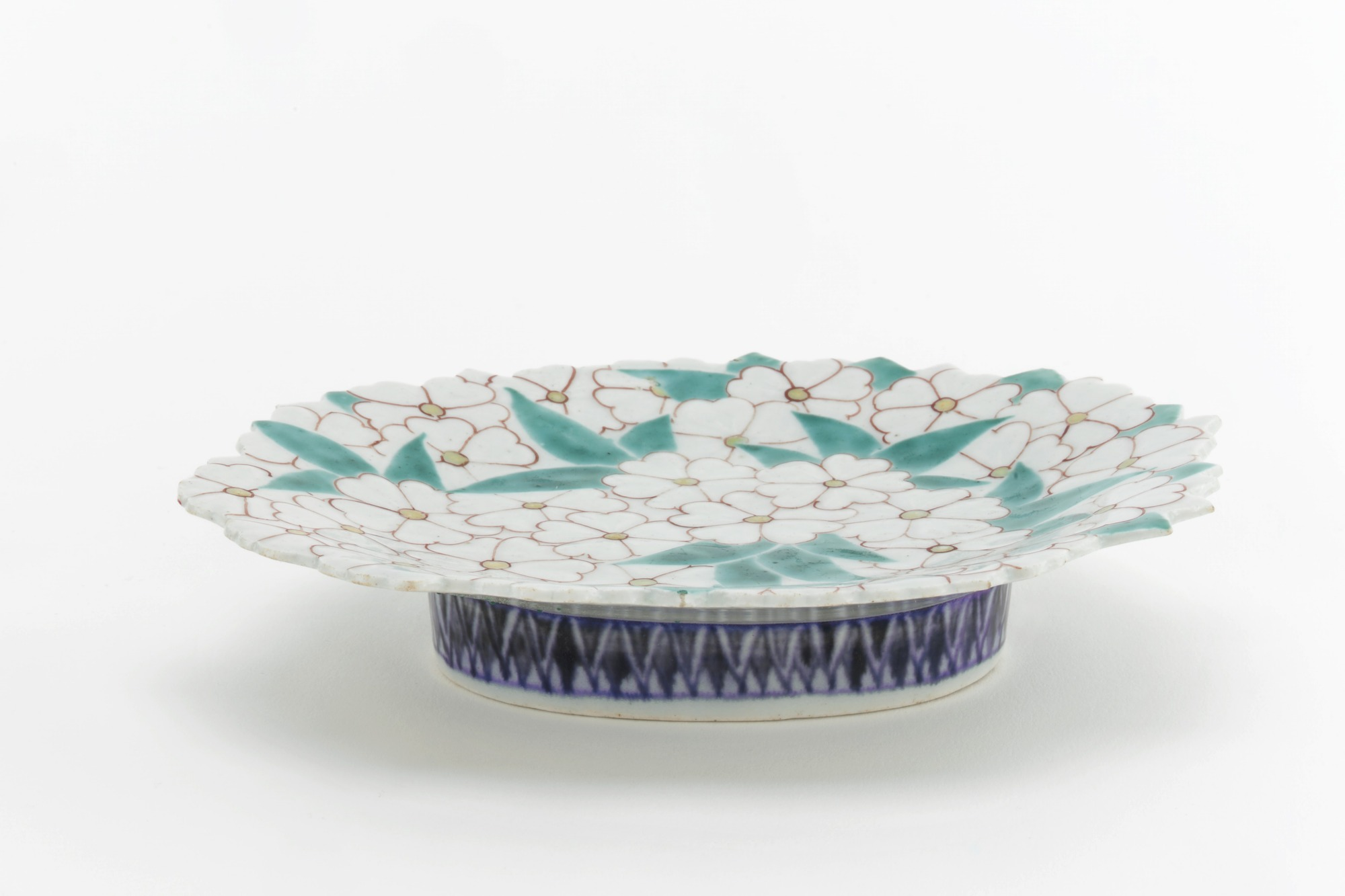 3/4 profile: Nabeshima ware dish molded in form of spray of cherry blossoms