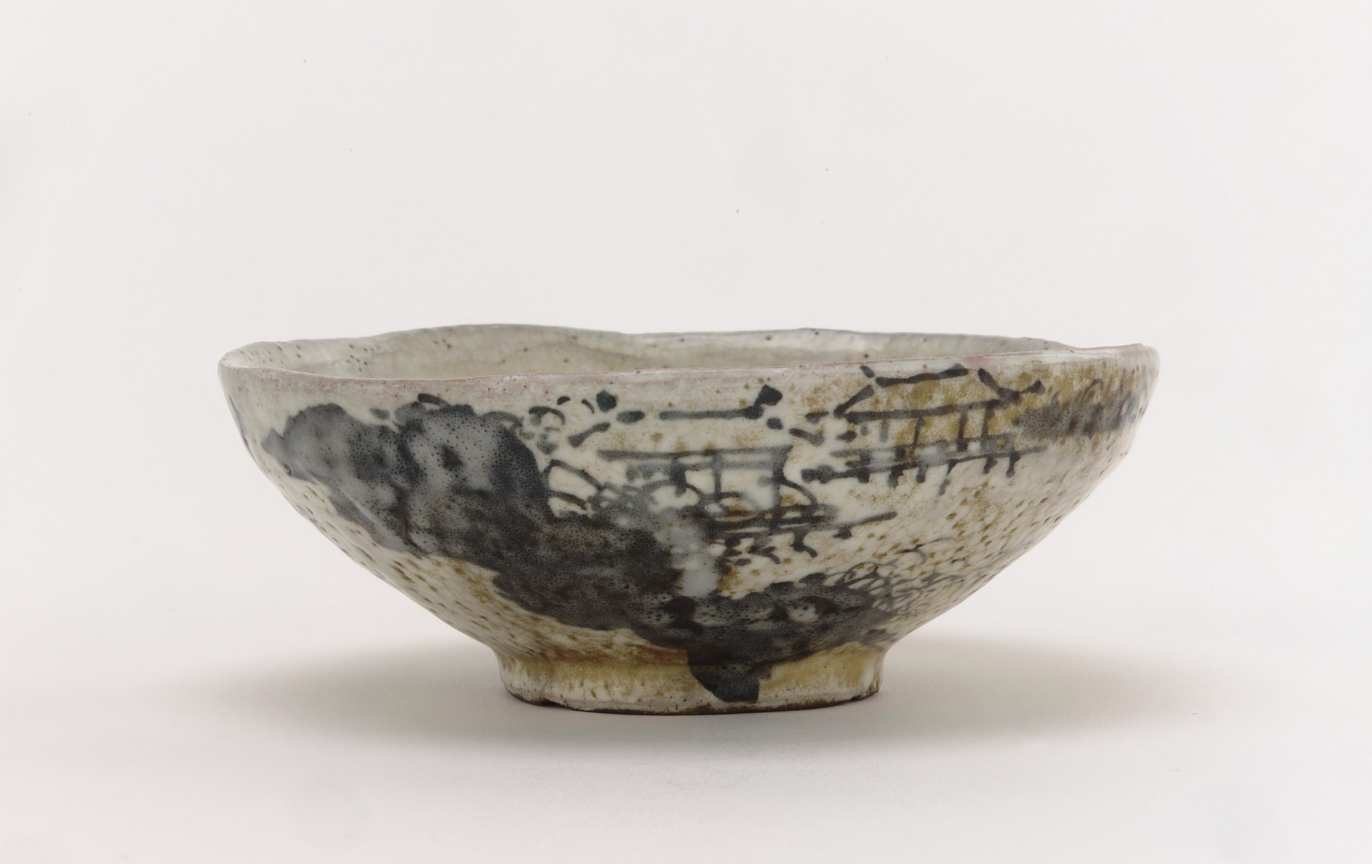 profile: Kenzan style tea bowl with design of mountain retreat