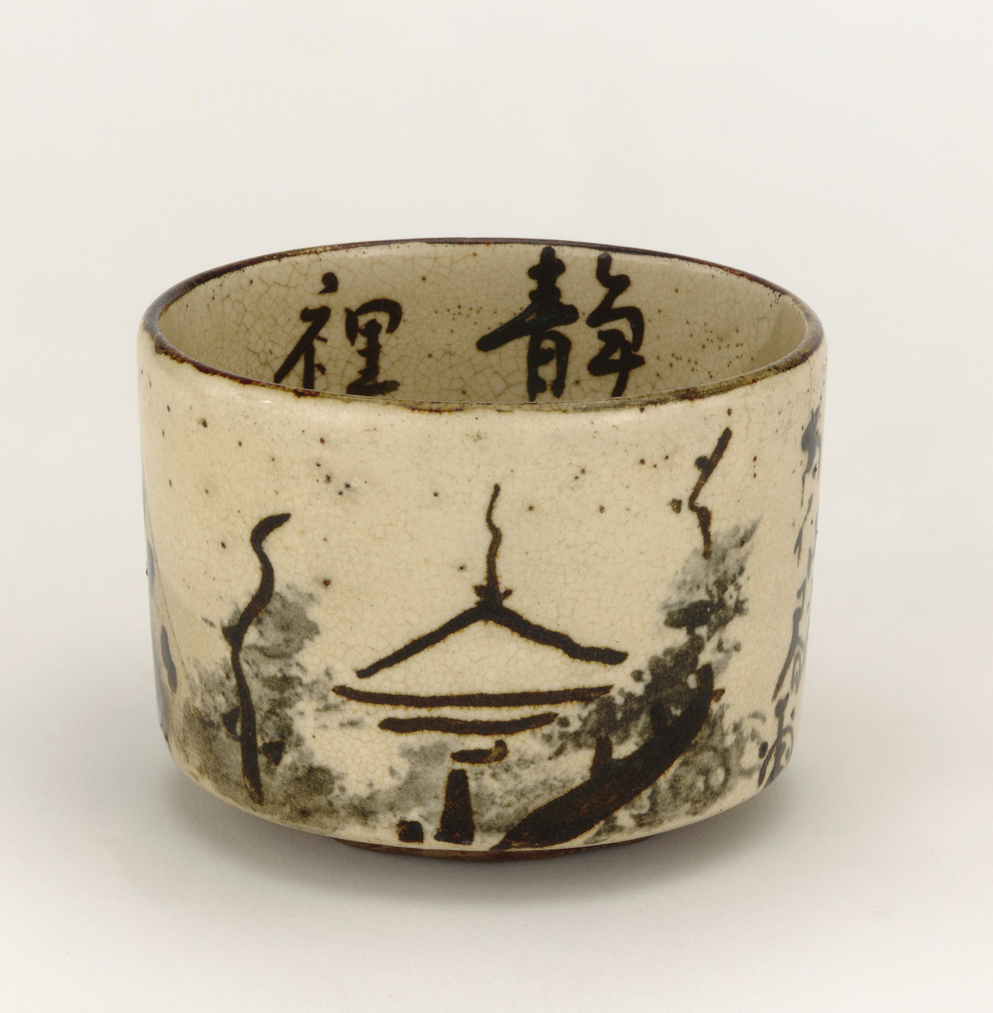 3/4 profile: Tea bowl with design of mountain retreat