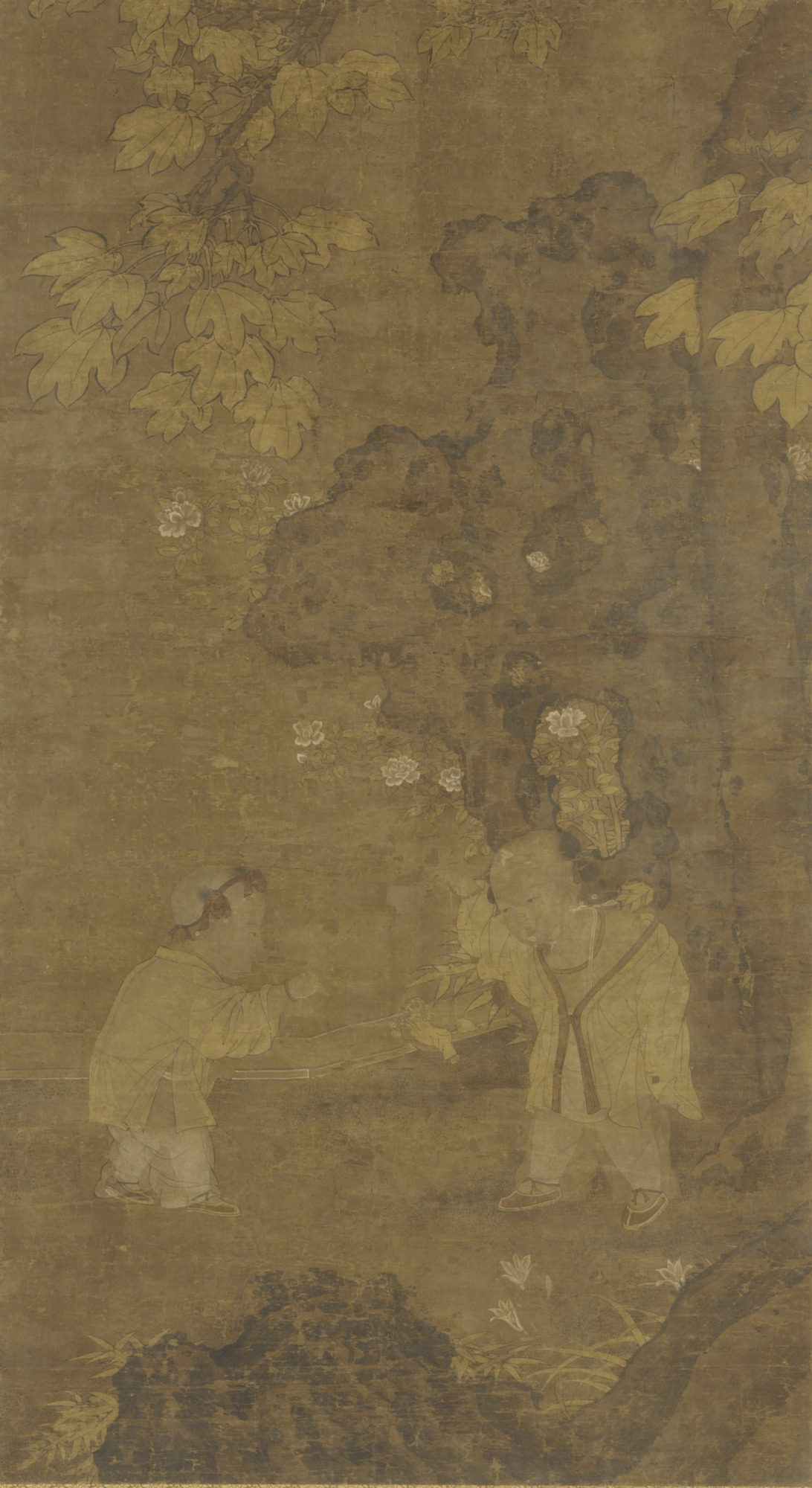 Two boys playing with the puppet of a lion