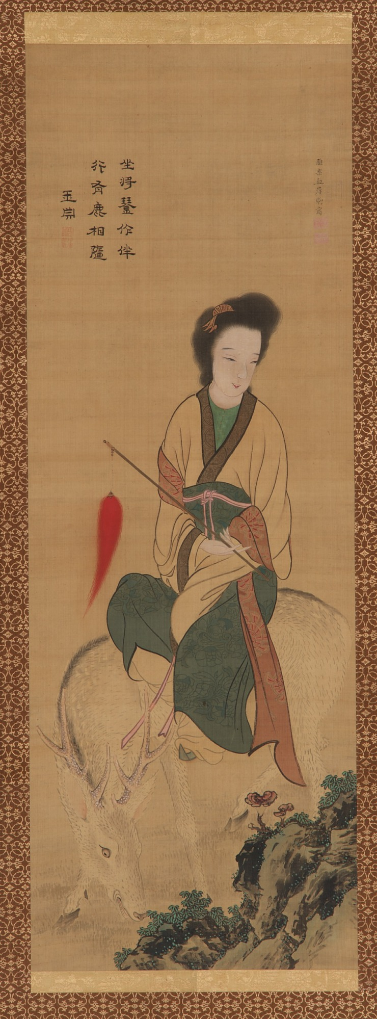 A female immortal riding on a white deer