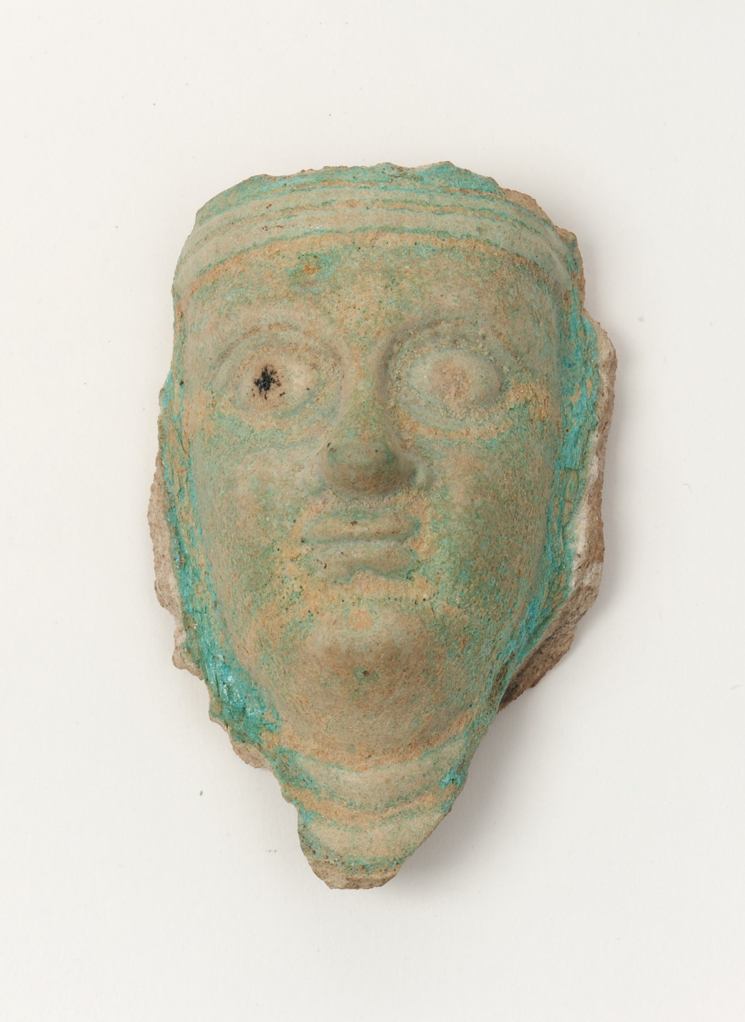 Fragment of a mask of a human face