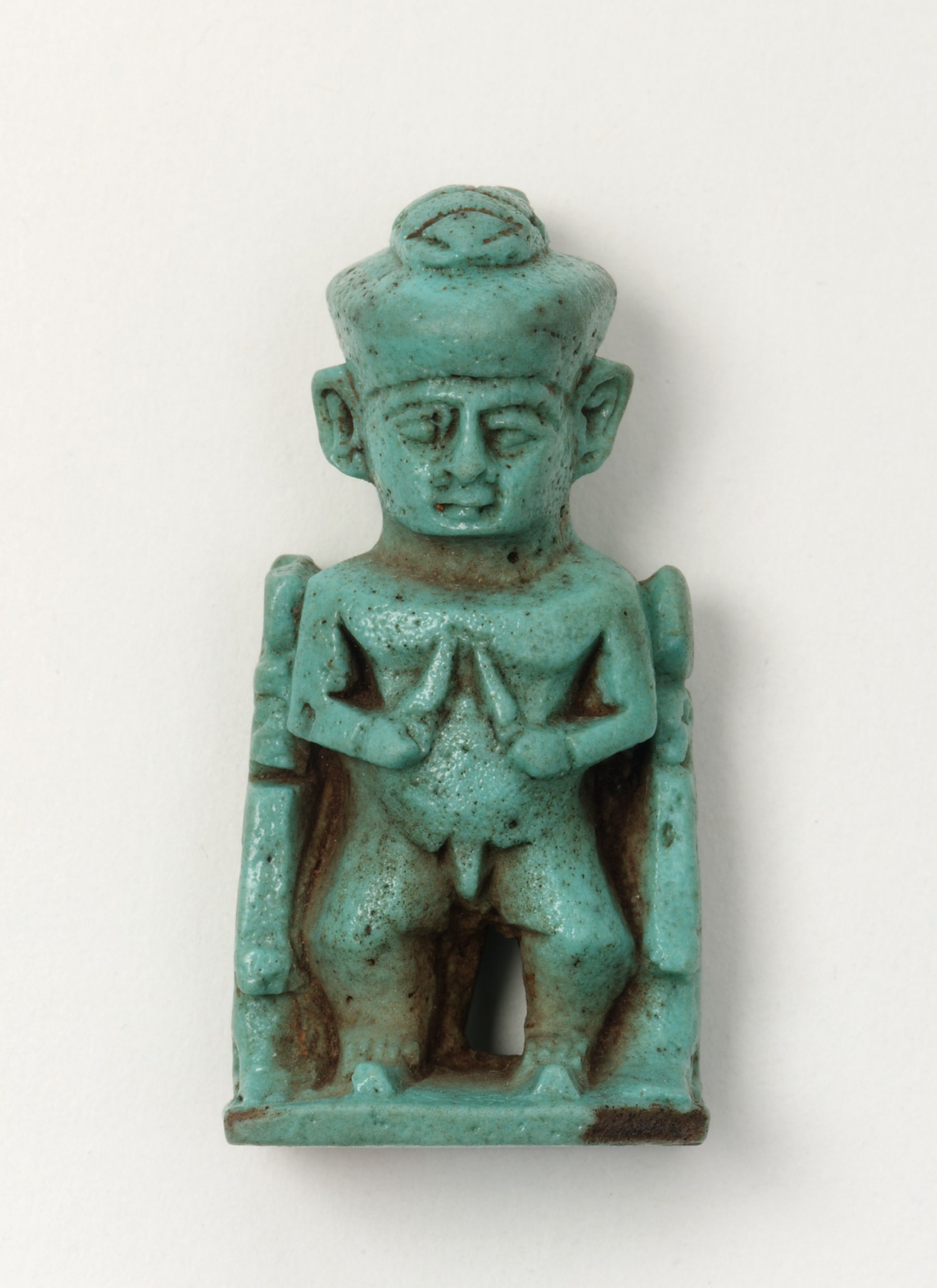 front: Amulet of dwarf god accompanied by Isis, Nephthys, and Nefertum