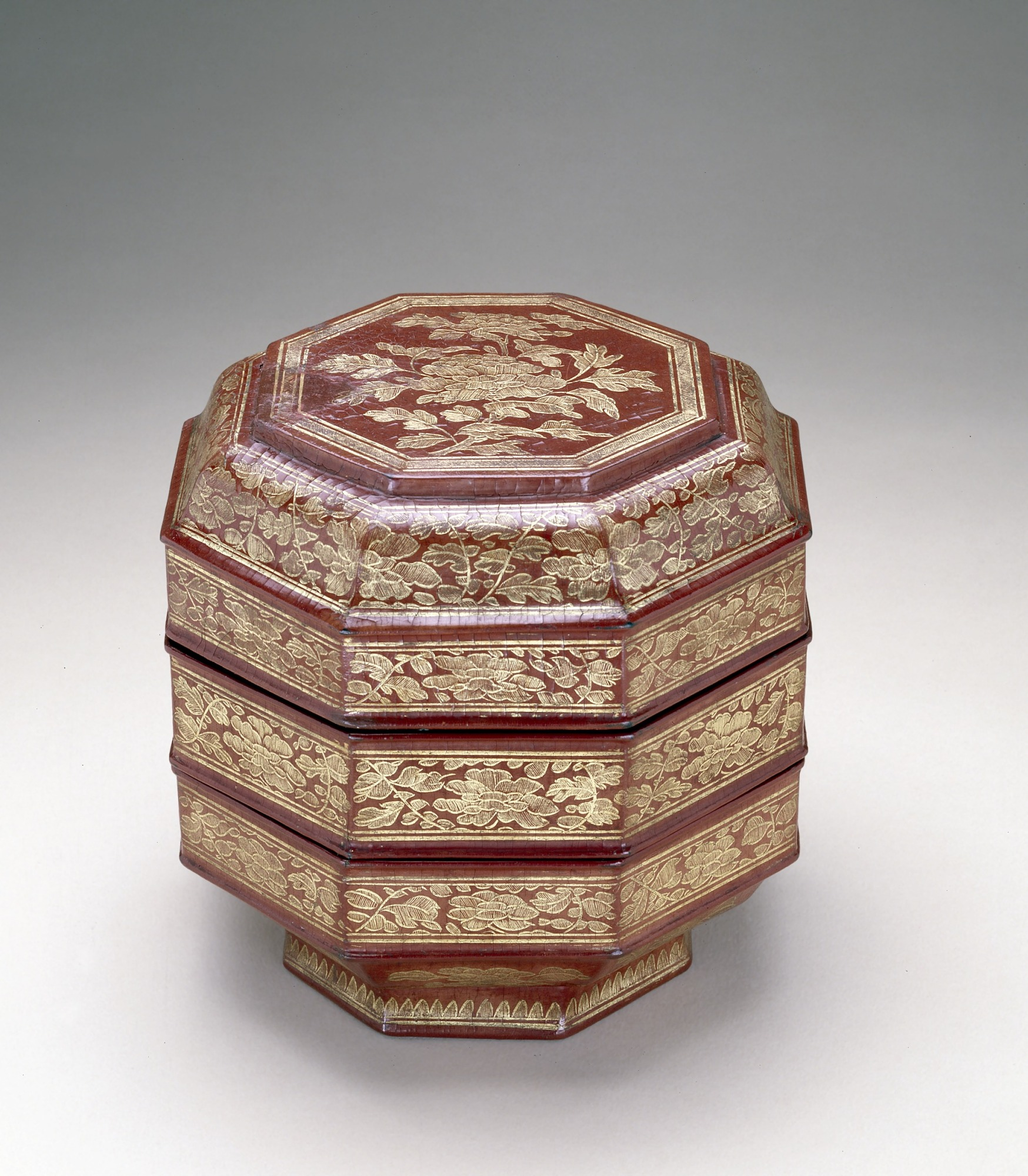 : Three-tiered octagonal food box with peony spray and scrolls