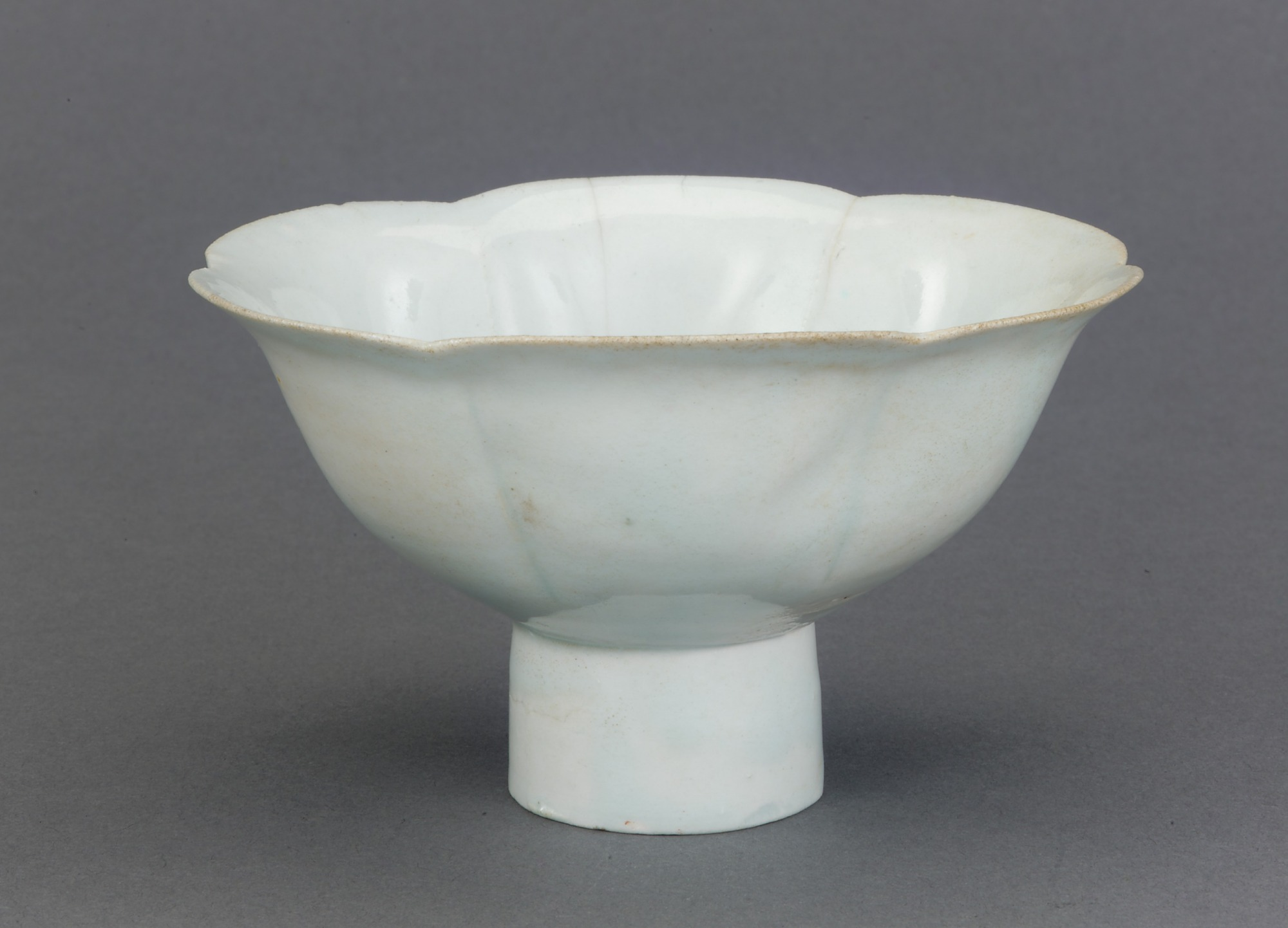 Bowl with foliate rim and tall foot