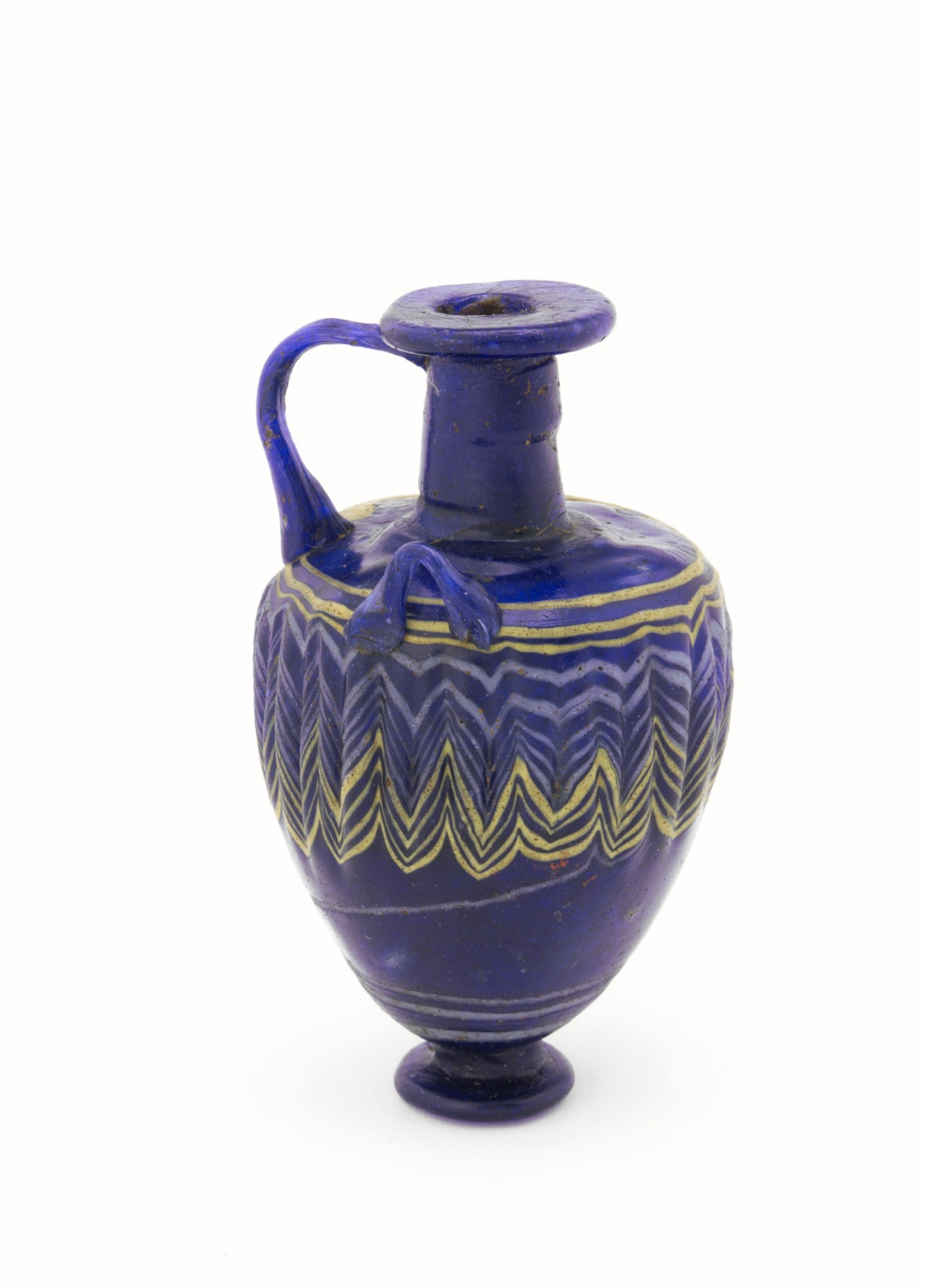 profile: Dark blue, three-handled jug with yellow and white dragged designs