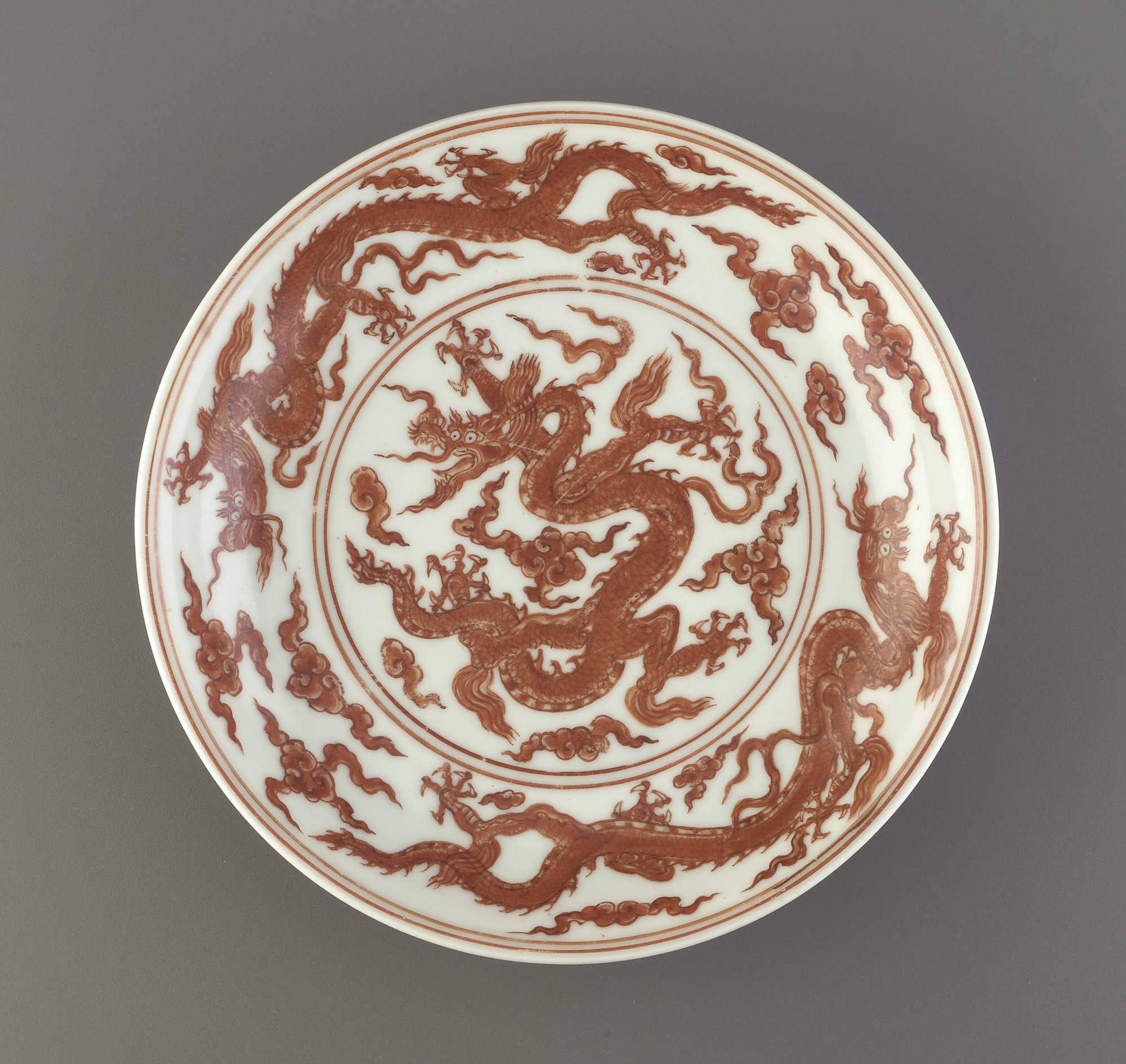 interior: Dish with design of dragons and clouds