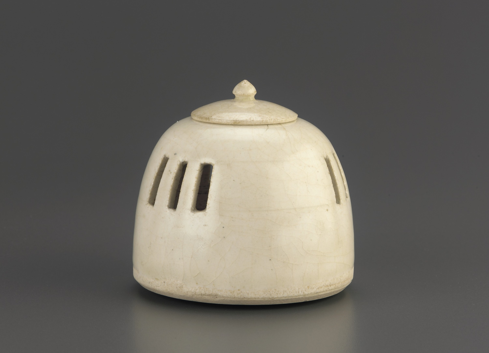 profile: Miniature hand warmer or incense burner with lid