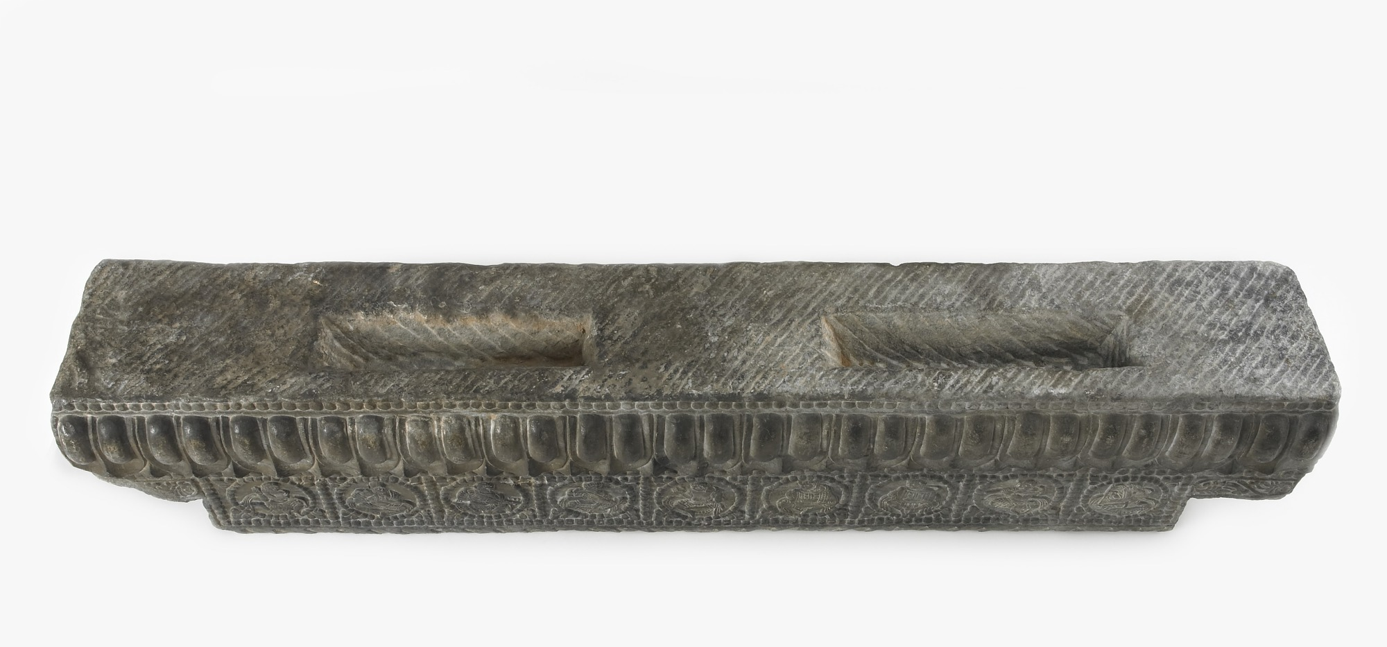 3/4 profile: Lateral stretcher from the base of a funerary couch with Sogdian musicians and a dancer