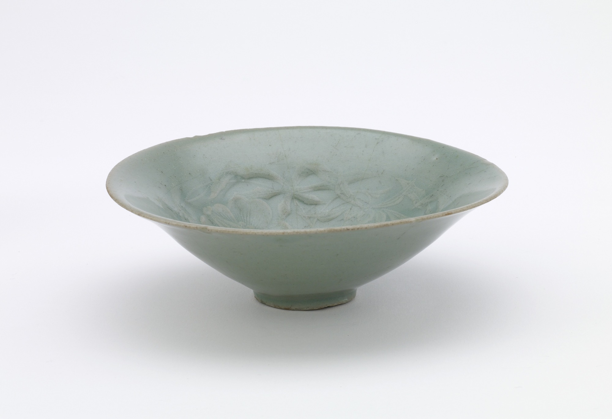 Bowl with molded decoration of hibiscus, profile