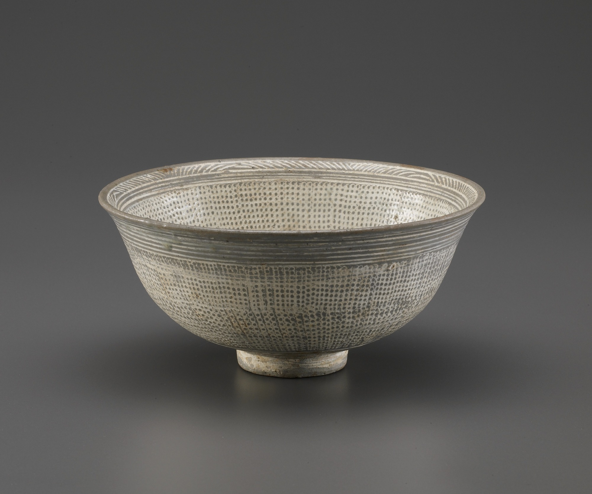 Bowl with stamped and incised decoration, profile