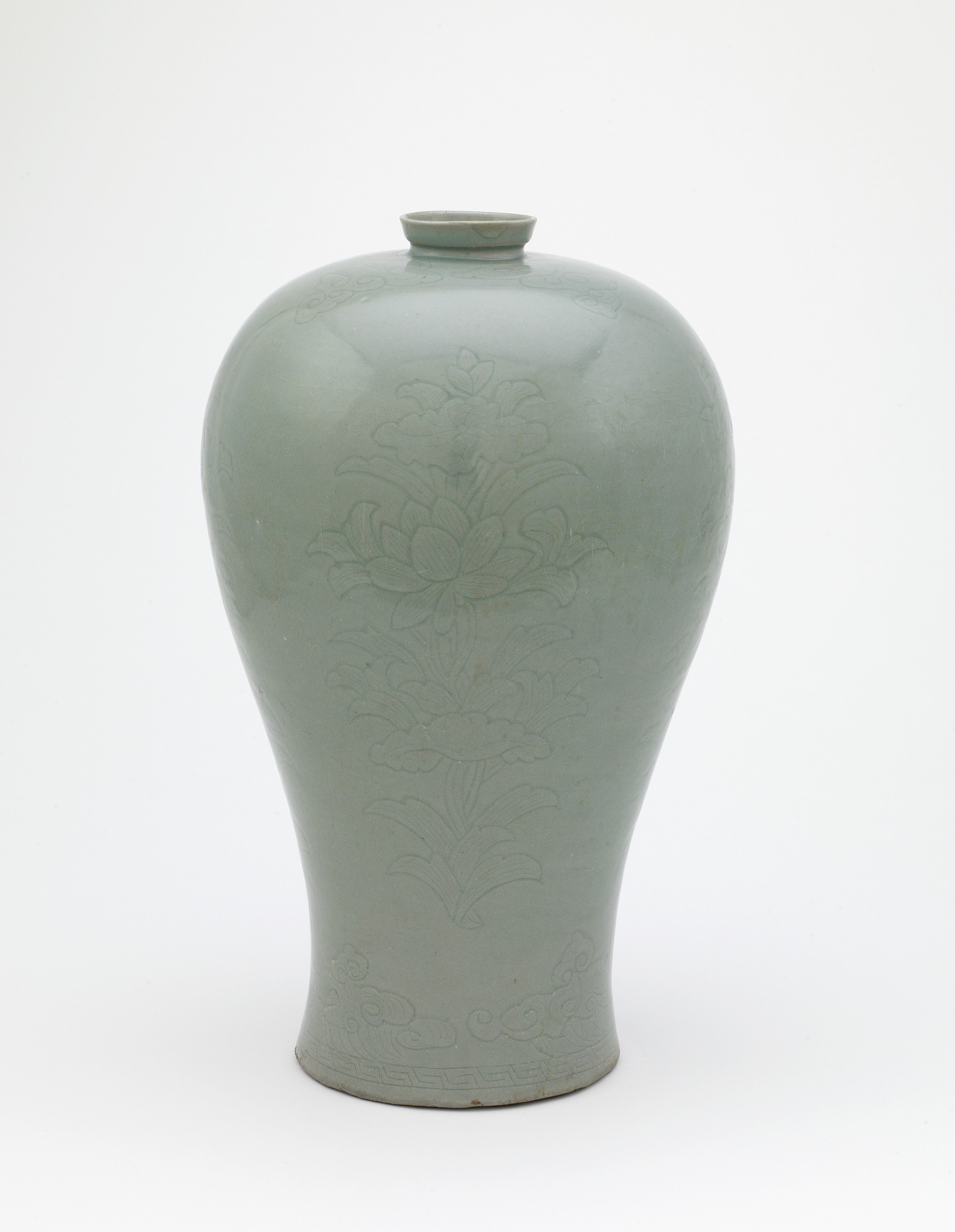 Bottle with incised design of four lotus sprays, profile