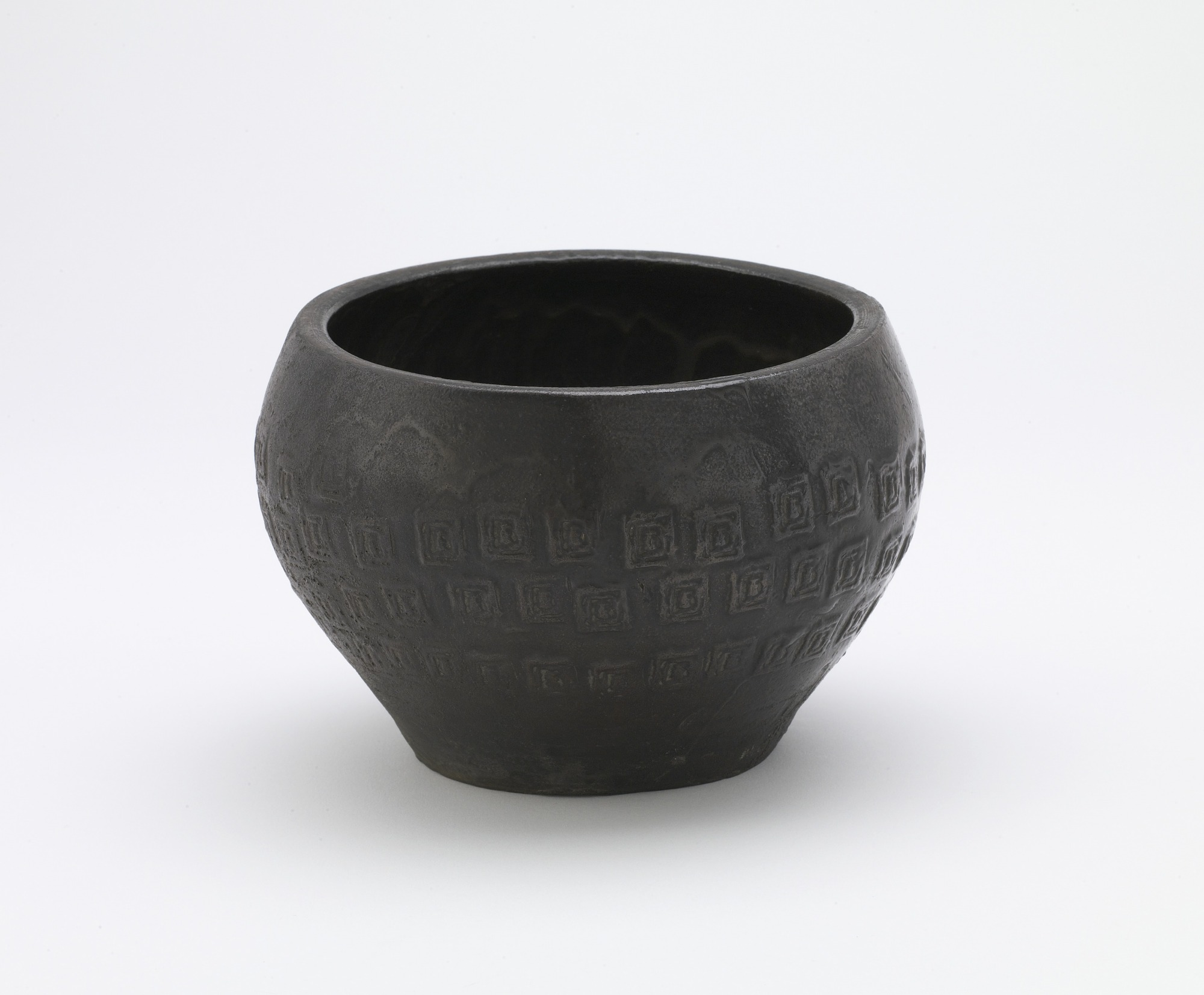 Bowl with stamp-impressed relief designs, 3/4 profile