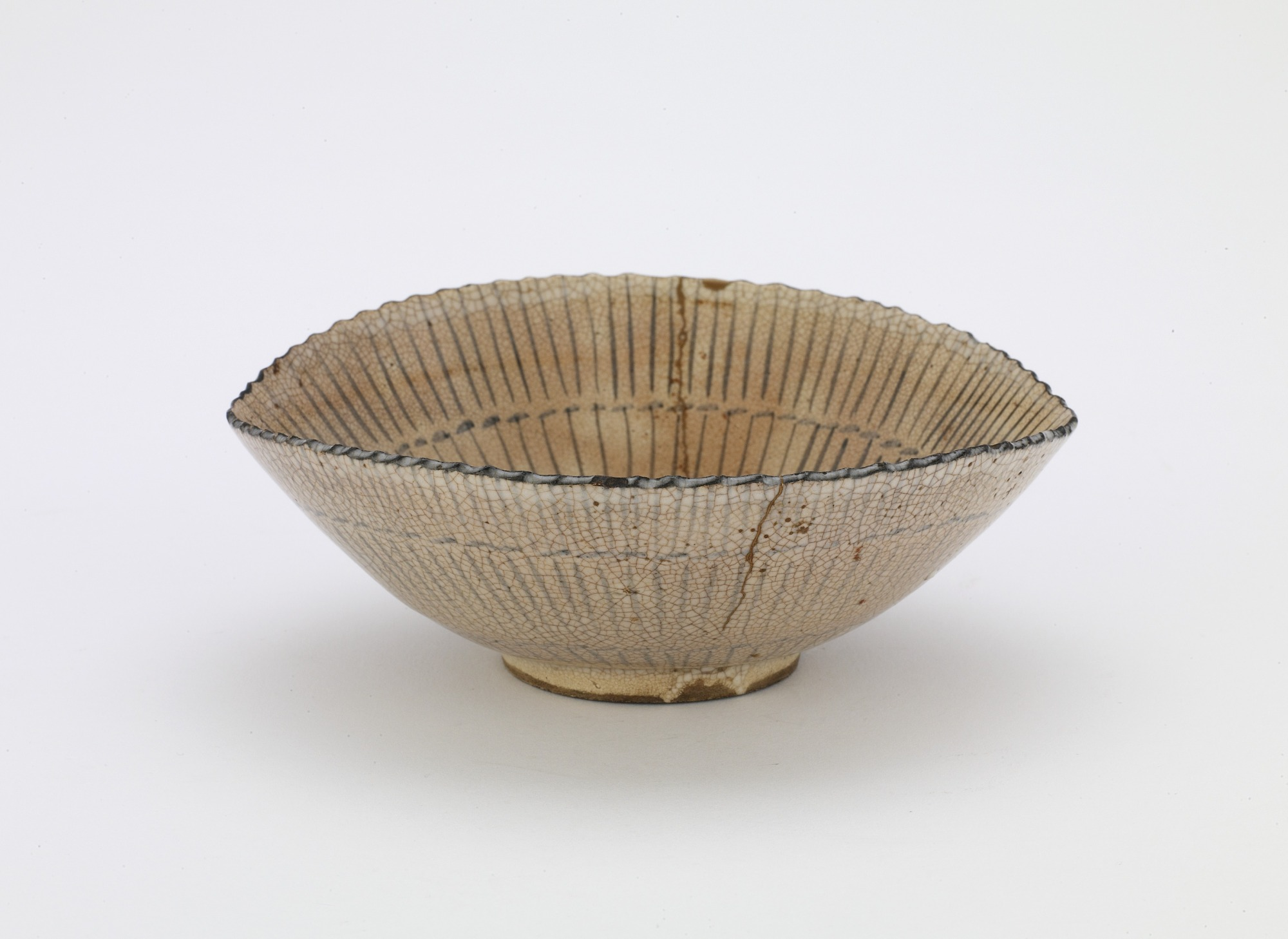 3/4 profile: Kyoto ware individual serving bowl in shape of sedge hat, with mark Kiyomizu