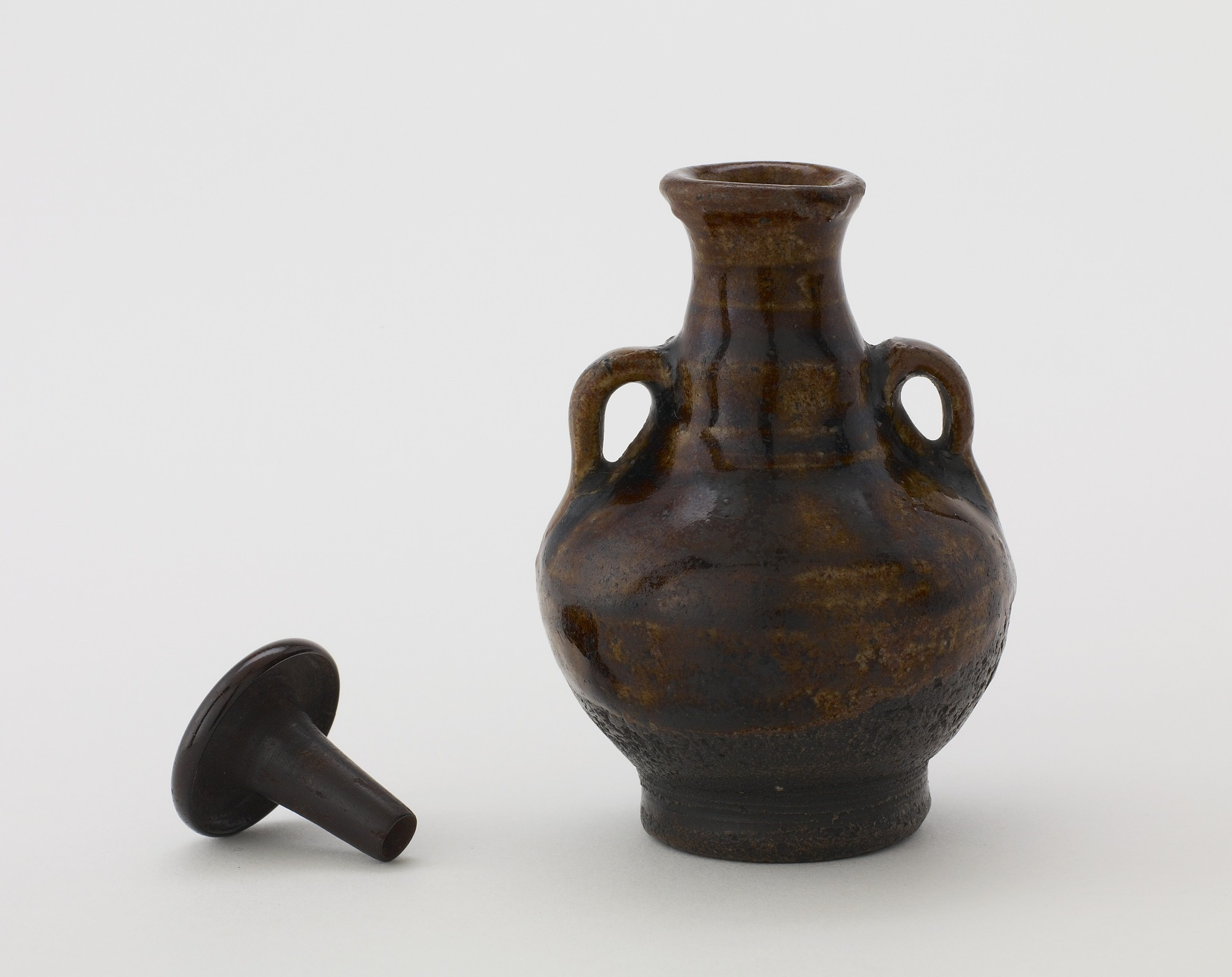 profile and lid: Bottle with two vertical ring hangles and lid