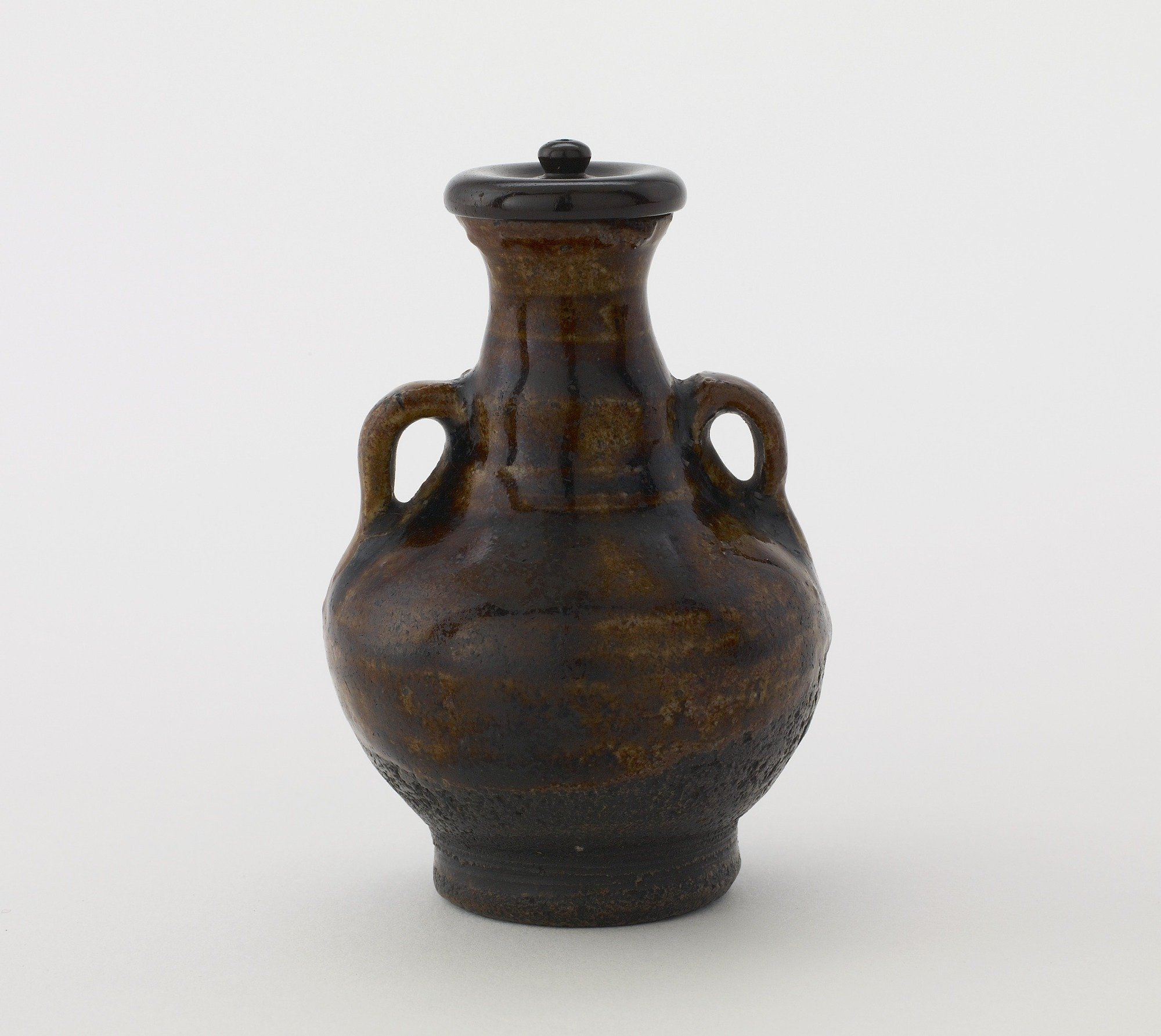 profile with lid: Bottle with two vertical ring hangles and lid