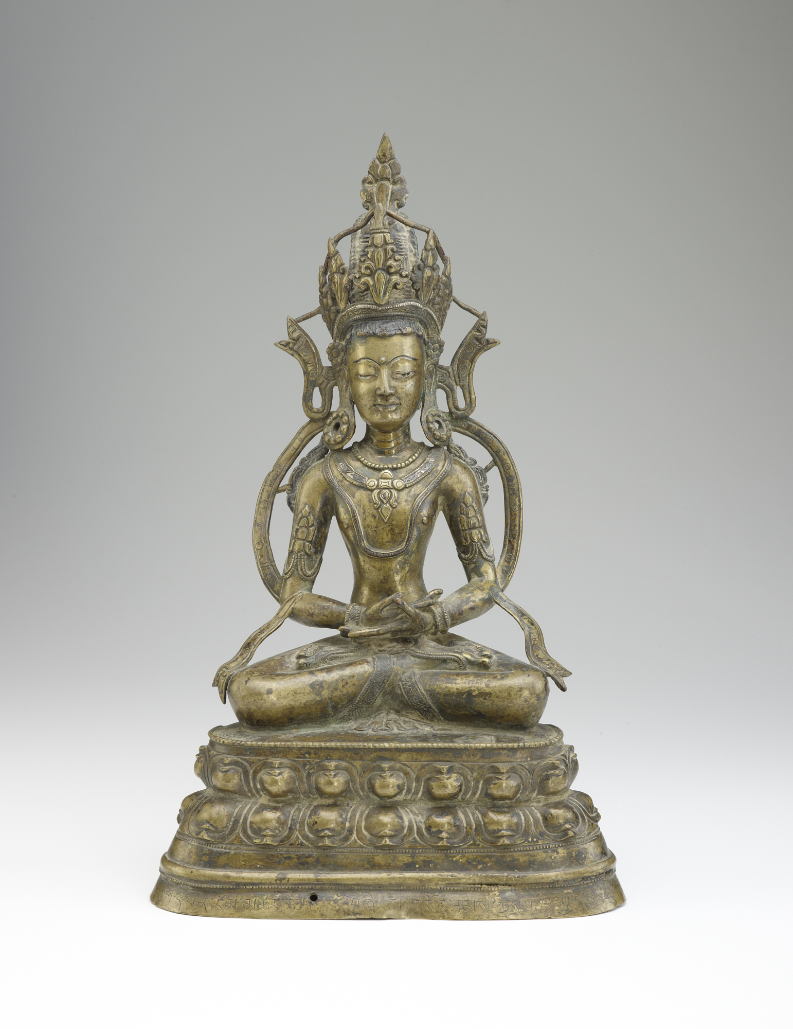 front: Figure of a seated bodhisattva