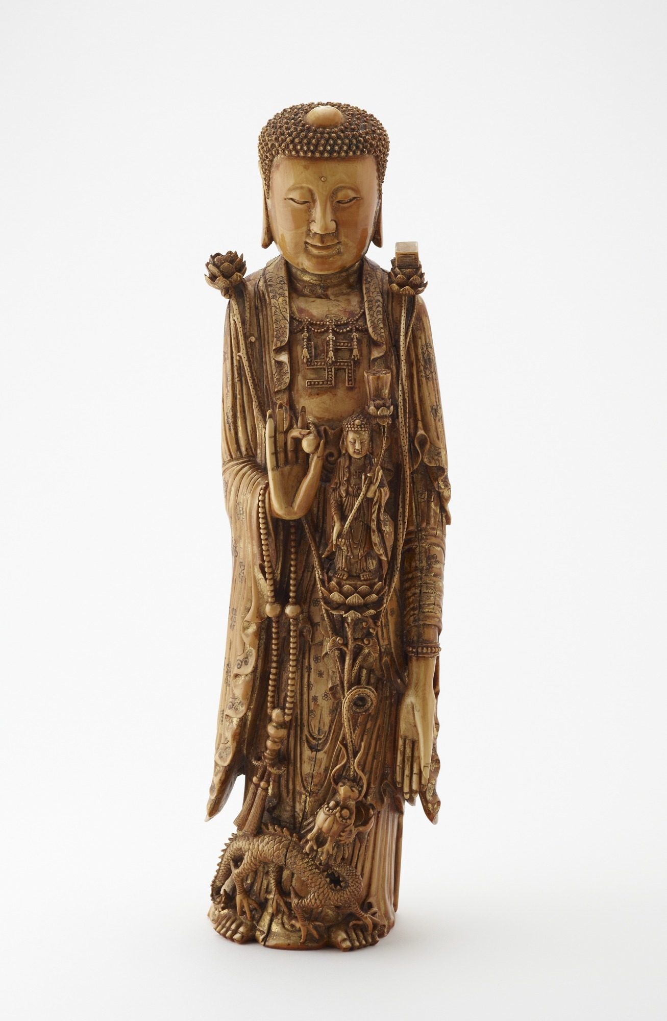 front: Possibly Bodhisattva Avalokitesvara (Guanyin) in the guise of a Buddha