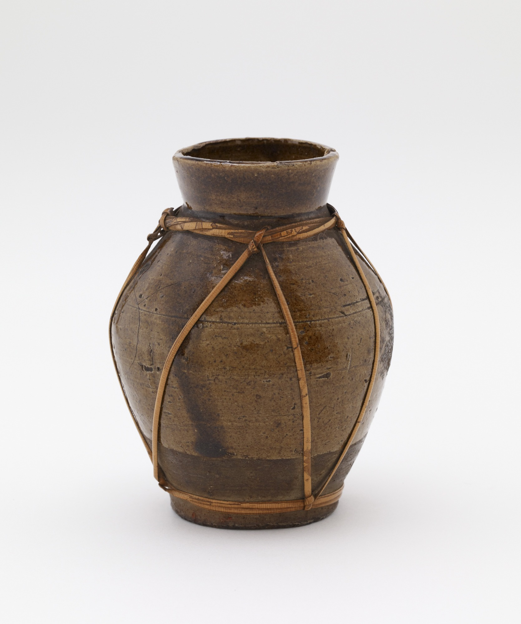 Jar with rattan harness