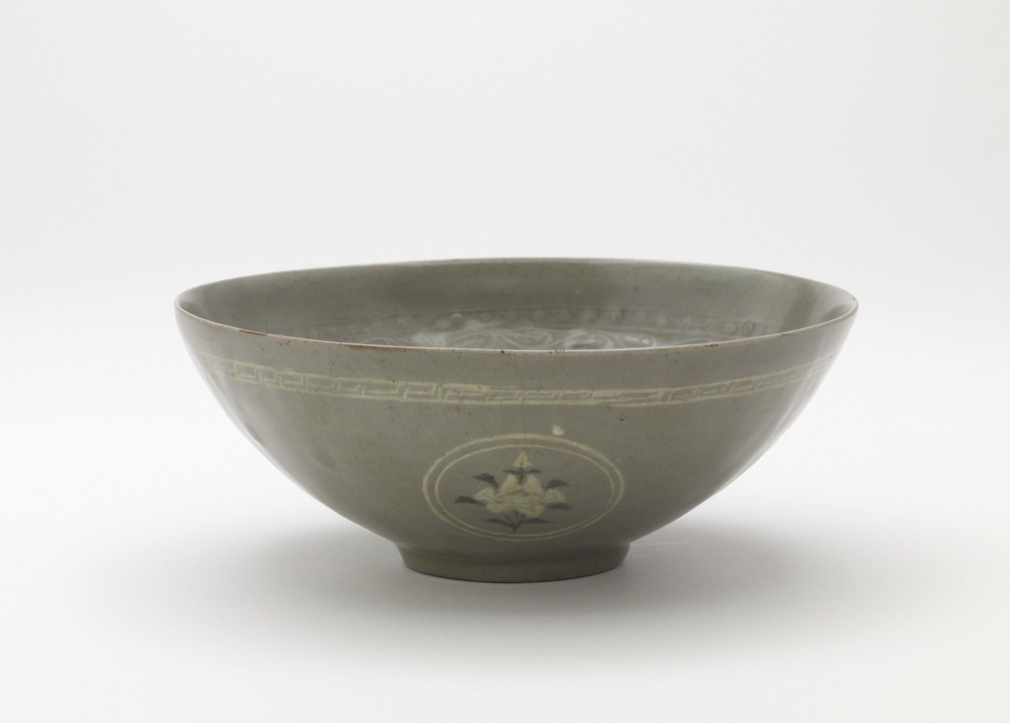 Bowl with molded and inlaid decoration, profile