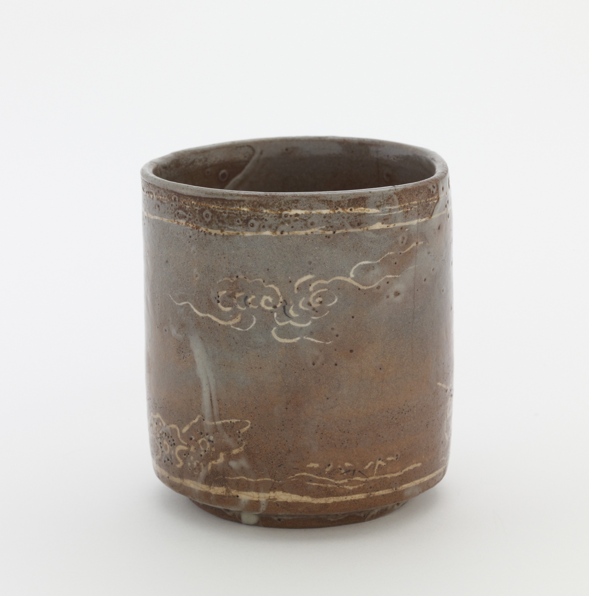 Cylindrical tea bowl with inlaid design of cranes and clouds, profile