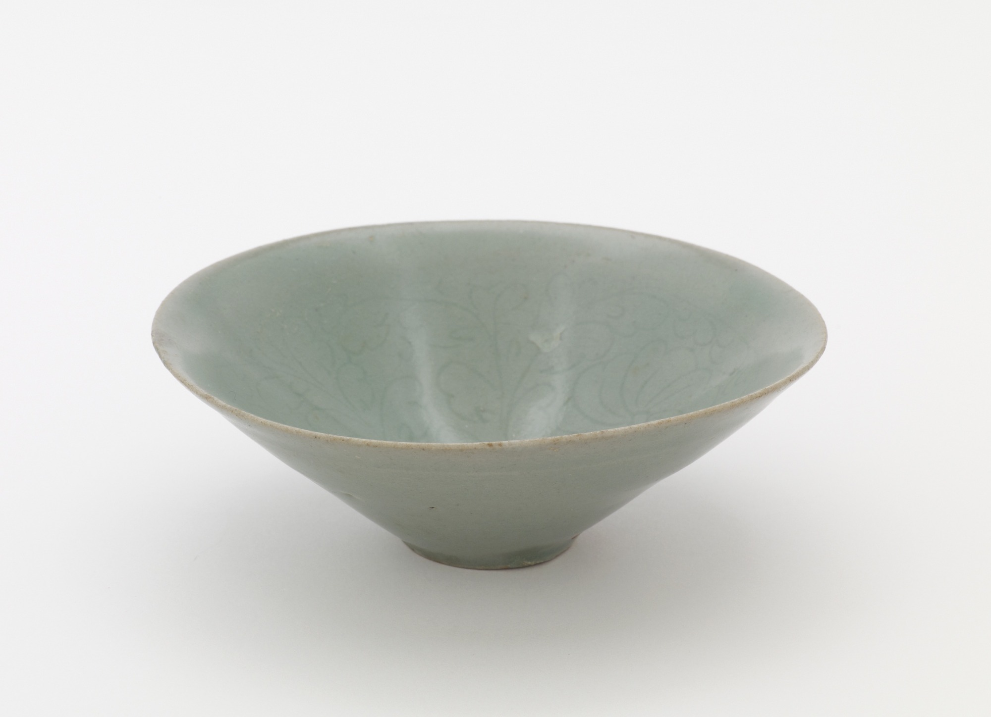 Bowl with incised design of chrysanthemums, 3/4 profile