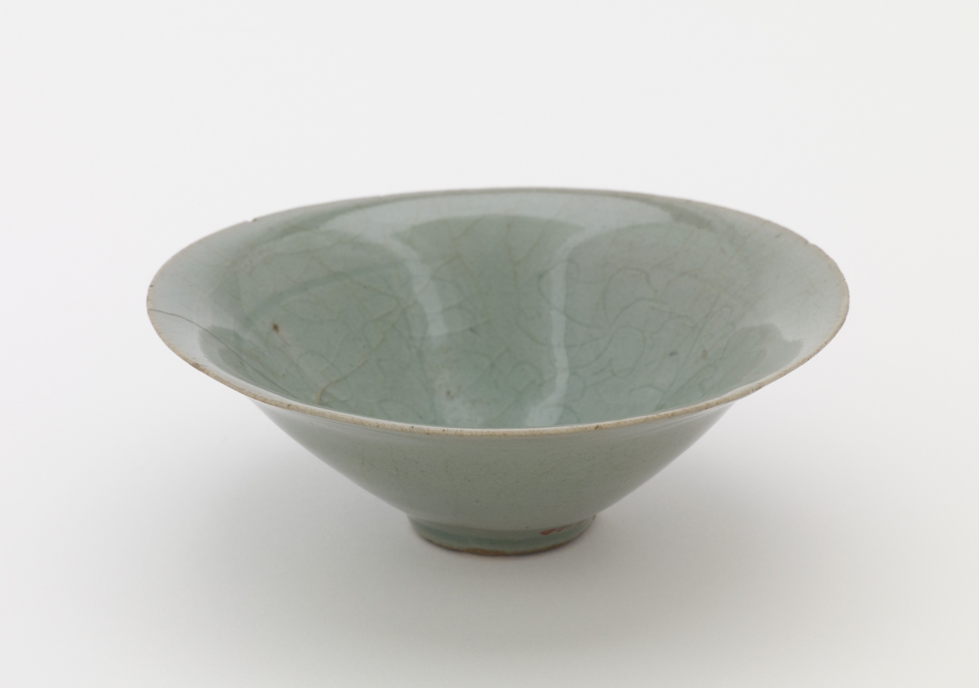 Bowl with incised design of floral spray, 3/4 profile