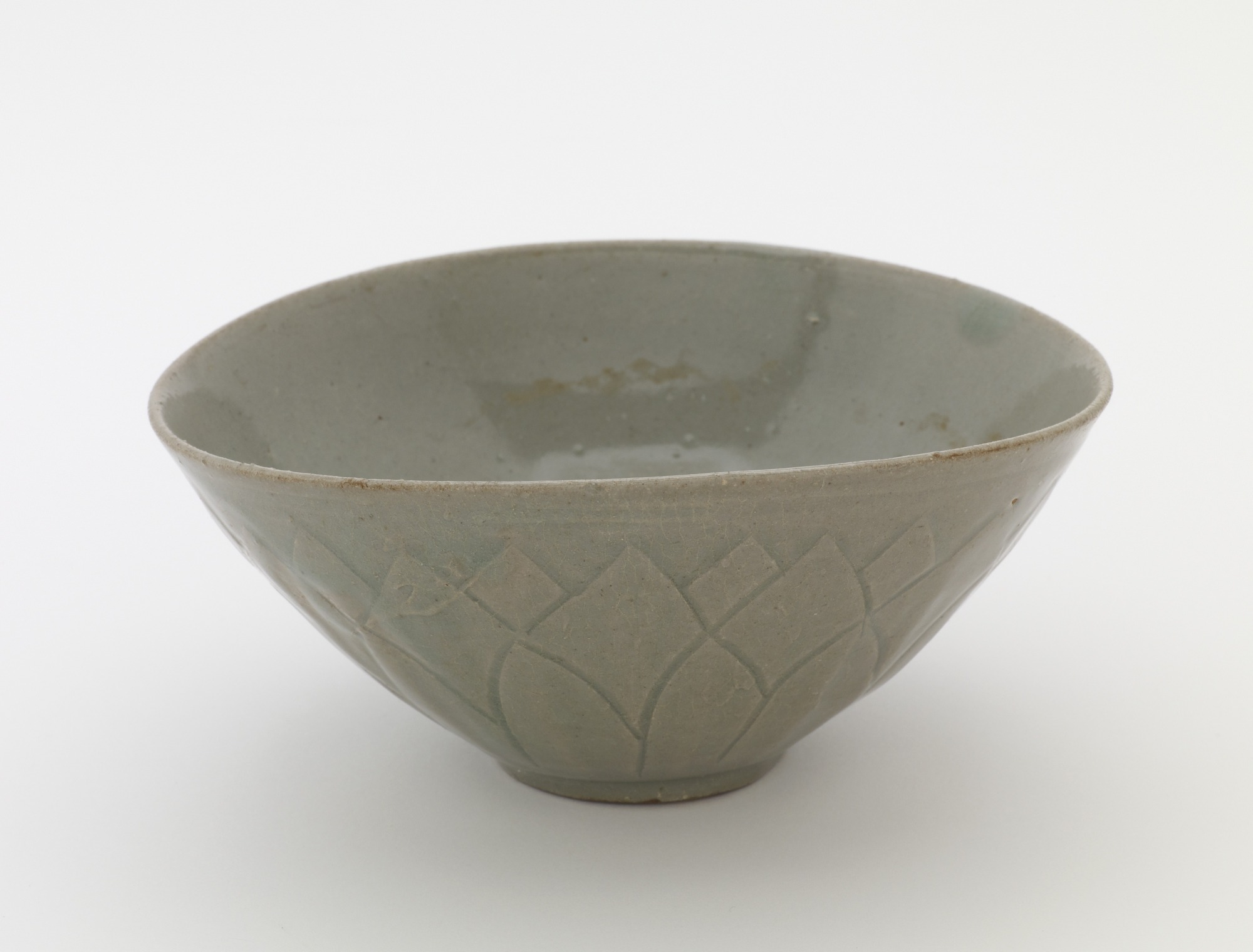 Bowl with molded and carved lotus decoration, 3/4 profile