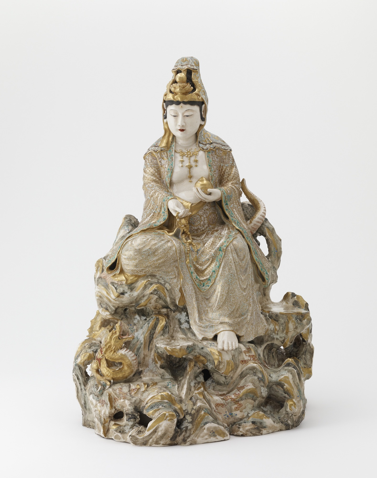 Seated Kannon and dragon