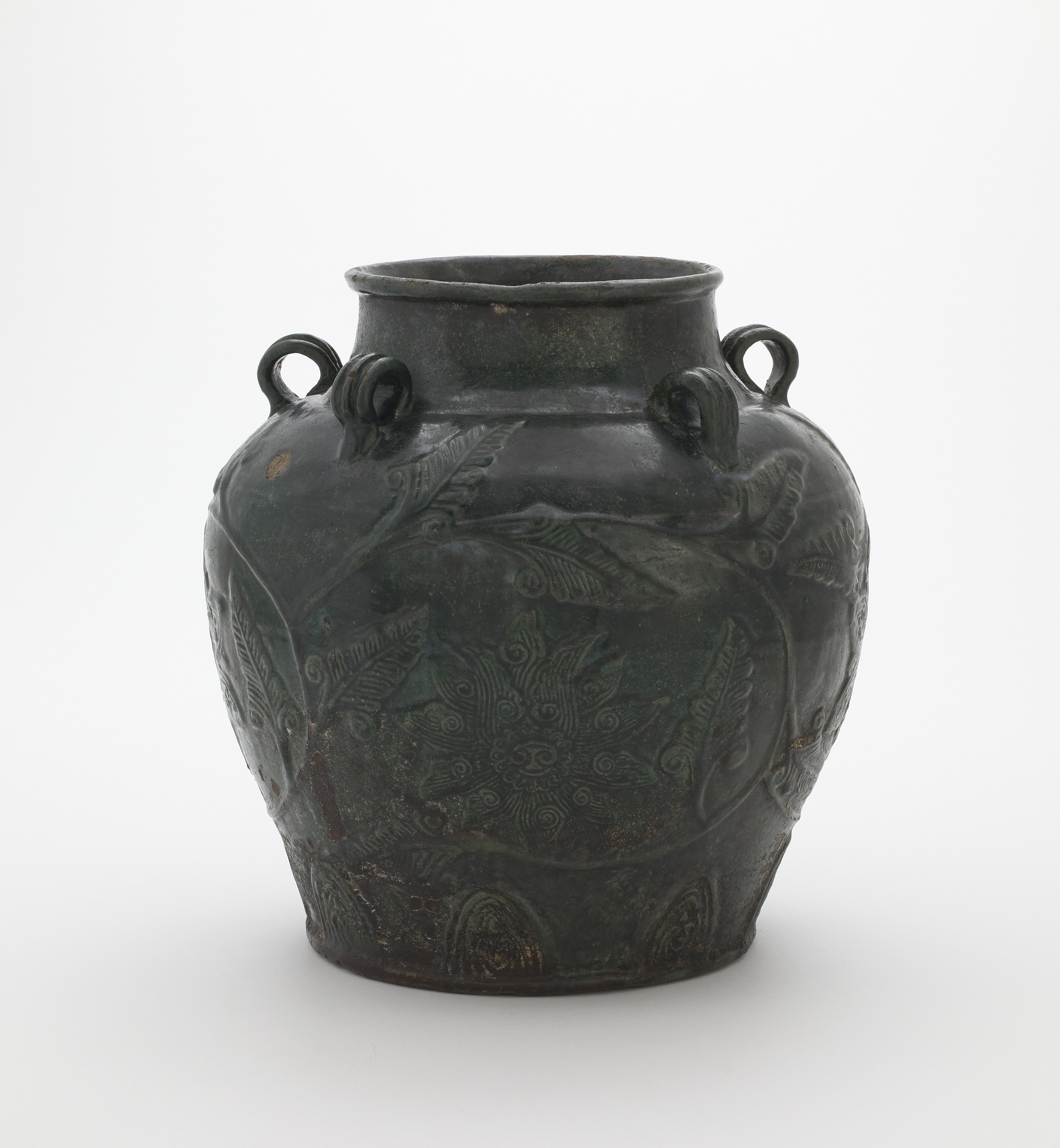 Zhangzhou ware jar with five loop handles and relief floral vinescroll decoration