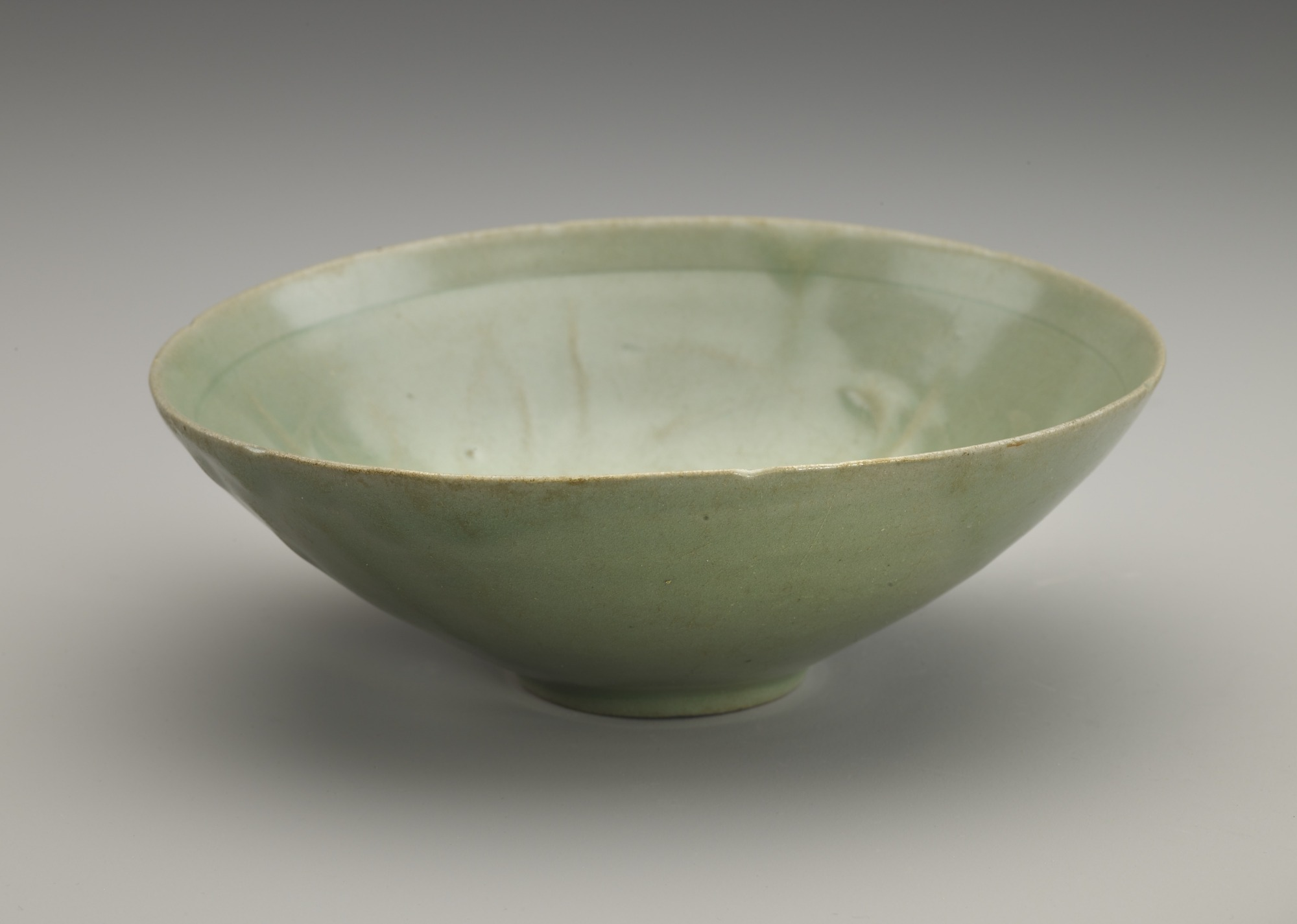 Bowl with molded design of peony, 3/4 profile