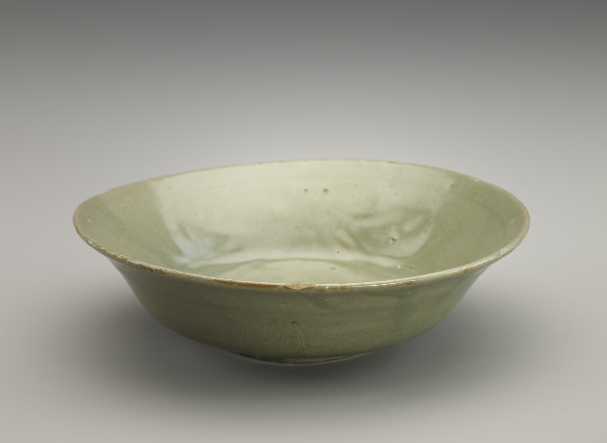 Dish with molded decor of single flower, 3/4  profile