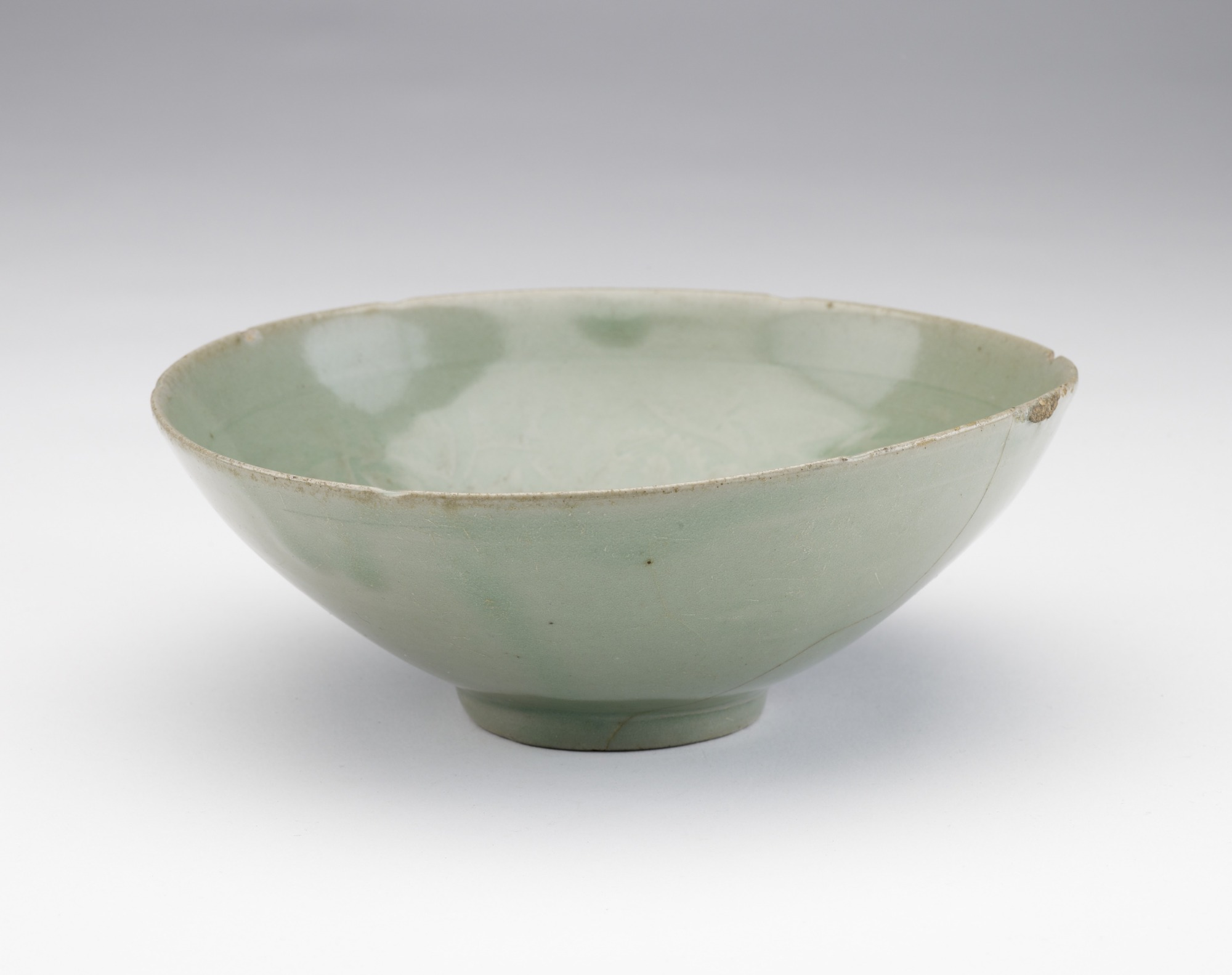 Bowl with molded and incised design of peony blossoms, profile