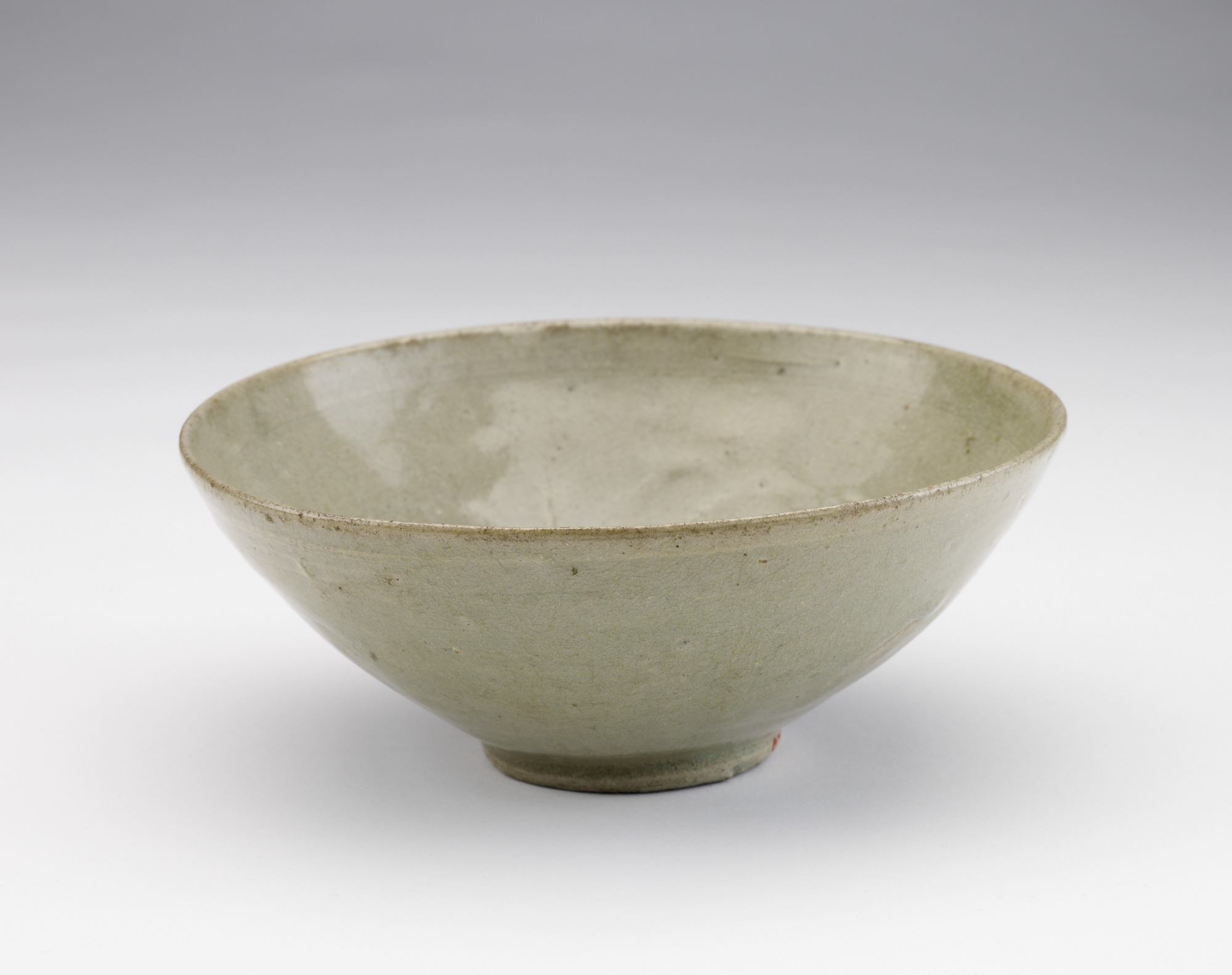 Bowl with molded decor of single flower, 3/4 profile